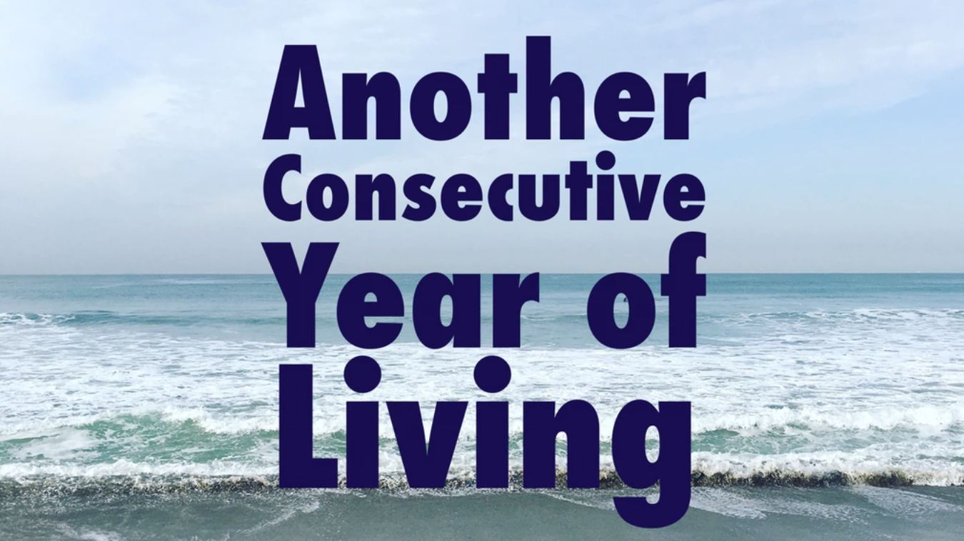 TICKETS   Another Consecutive Year of Living is a serial birthday play about Evan Garretts 29th year on this planet. Starting on May 12th, 2019, Evan will write and perform a 30-minute play every week to illuminate the events that occurred that week. In 2020, for his 30th birthday, he will perform all 48 plays in one 24-hour event. The goal: create a process piece communicating how one person can change over the course of 52 weeks.  For Evan, this epic process is a question about if he can consistently make art he believes in when confronted with the repetition of life. Currently working as an accountant, he is looking to reach back to the love of creating theater he once had. Will this play light a path for Evan to continue on? Or will it act as a love letter saying good-bye to a dream-- exhausting the creative air from within him and reifying himself to the endless excel sheets on his screen? Each week will guide him along the way; maybe at 30 he will learn which way he wants to go...