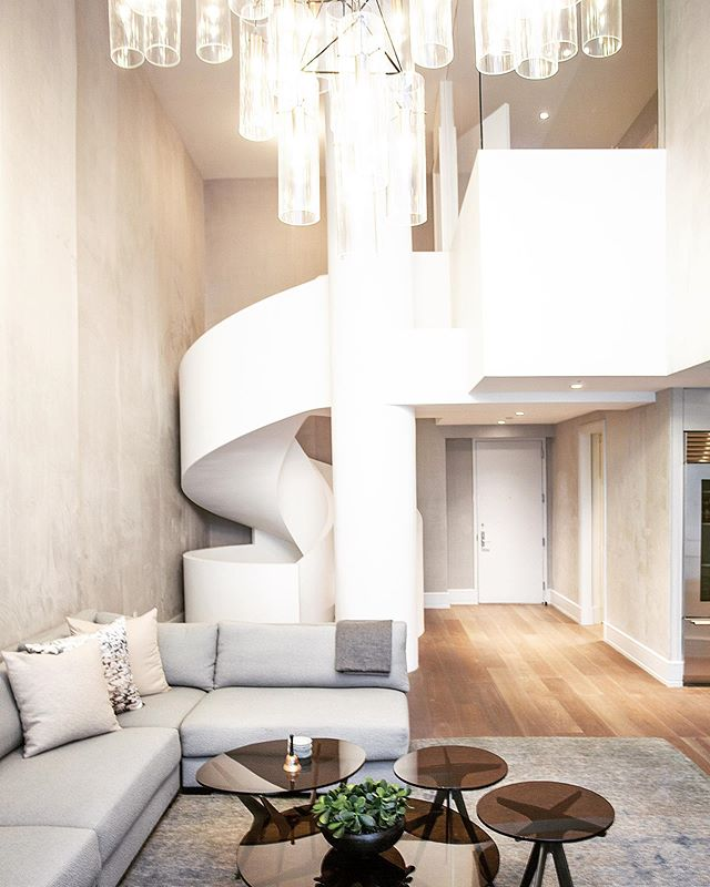 A lovely living room to relax and enjoy company with, accented by this beautifully dramatic staircase.  Architecture by : @lichtenarchitects  Interior design by: @michellegersoninteriors . . . . #staircase #stair #architecture #design #customstaircase #ribbonstair #interiordesign #interiors #ues #kevinlichten #architects #details #apartment #modern #residentialarchitecture #moderndesign #instaarchitecture #newyorkapartments #nyc #ues #beautifuldesign #nycliving #archilovers #architecturelovers #architecturalphotography #architecturaldetail