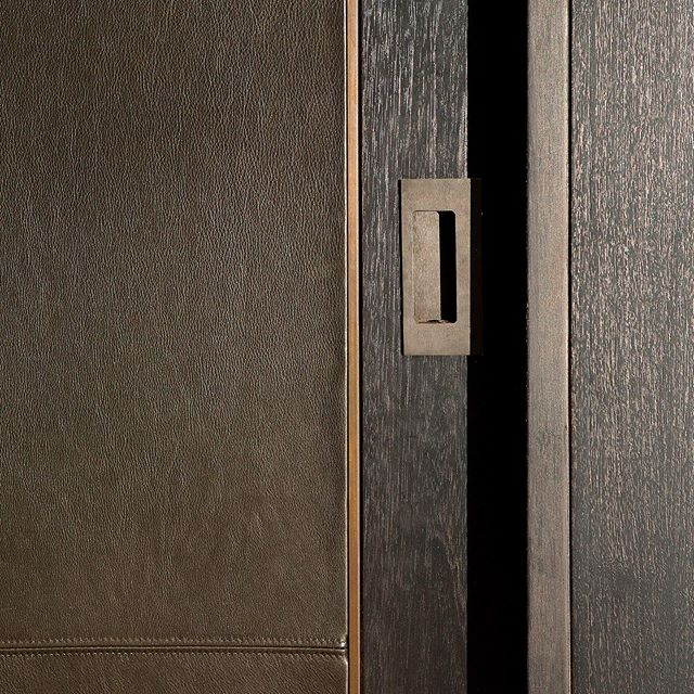 It's all in the details! This ebonized wood and bronze millwork provides a sleek and rich look.  Architecture by @lichtenarchitects . . . . . . . #nycapartment #glamorousdesign #bronzehardware #ebonizedwood #details #hardwaredetail #architecture #design #interiordesign #interiors #ues #kevinlichten #architects #details #apartment #modern #residentialarchitecture #moderndesign #instaarchitecture #newyorkapartments #nyc #ues #beautifuldesign #nycliving #archilovers #architecturelovers #architecturalphotography #architecturaldetail
