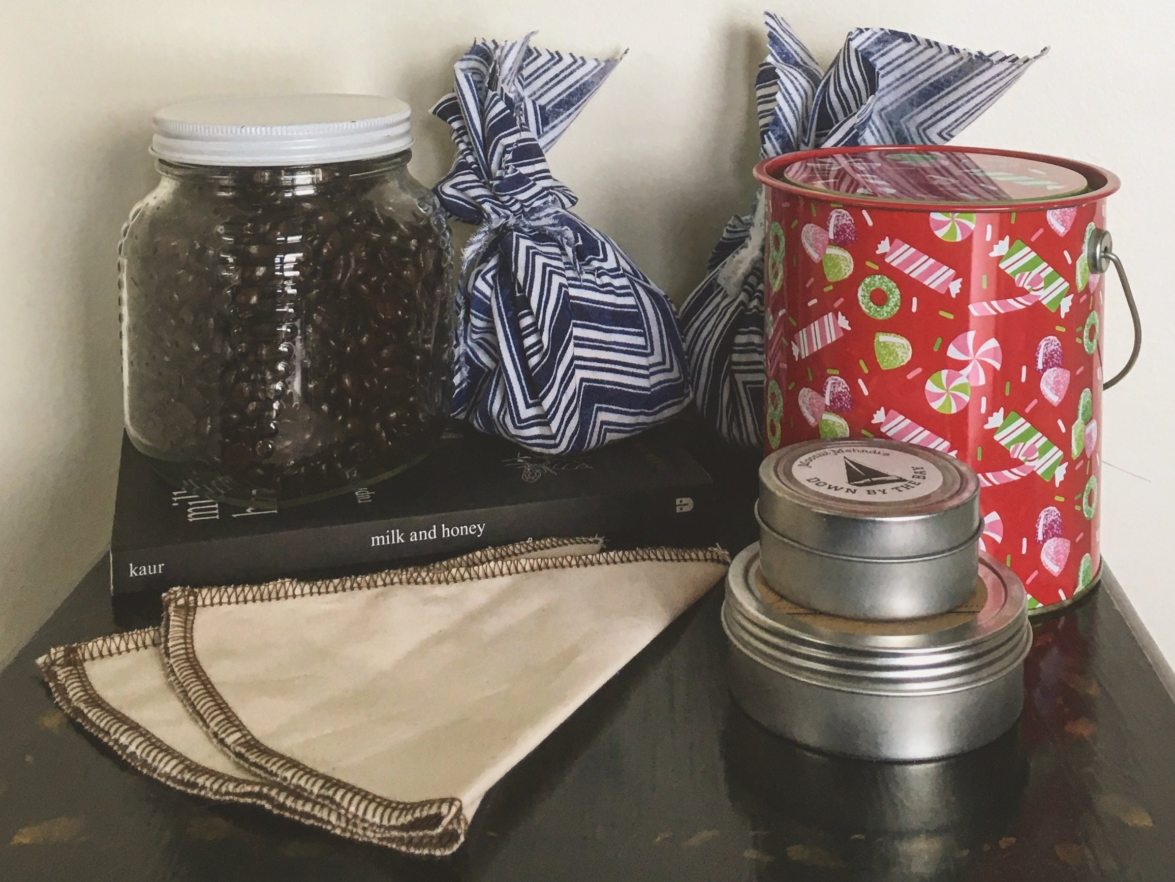 Zero waste gifts I received last Christmas: package free coffee, cloth wrapped bath bombs, locally made lotion bars, a used book, and reusable Coffee Sock coffee filters