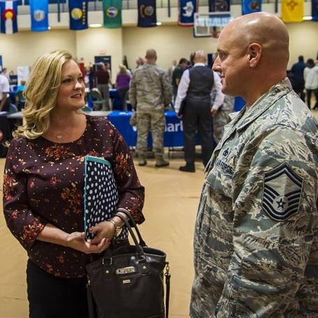 Civilian woman talking to veteran