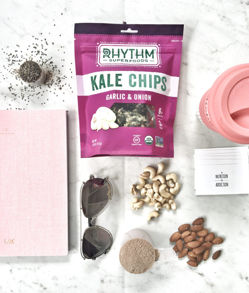 kale chips, nuts, protein powder, chia seeds, journal, sunglasses
