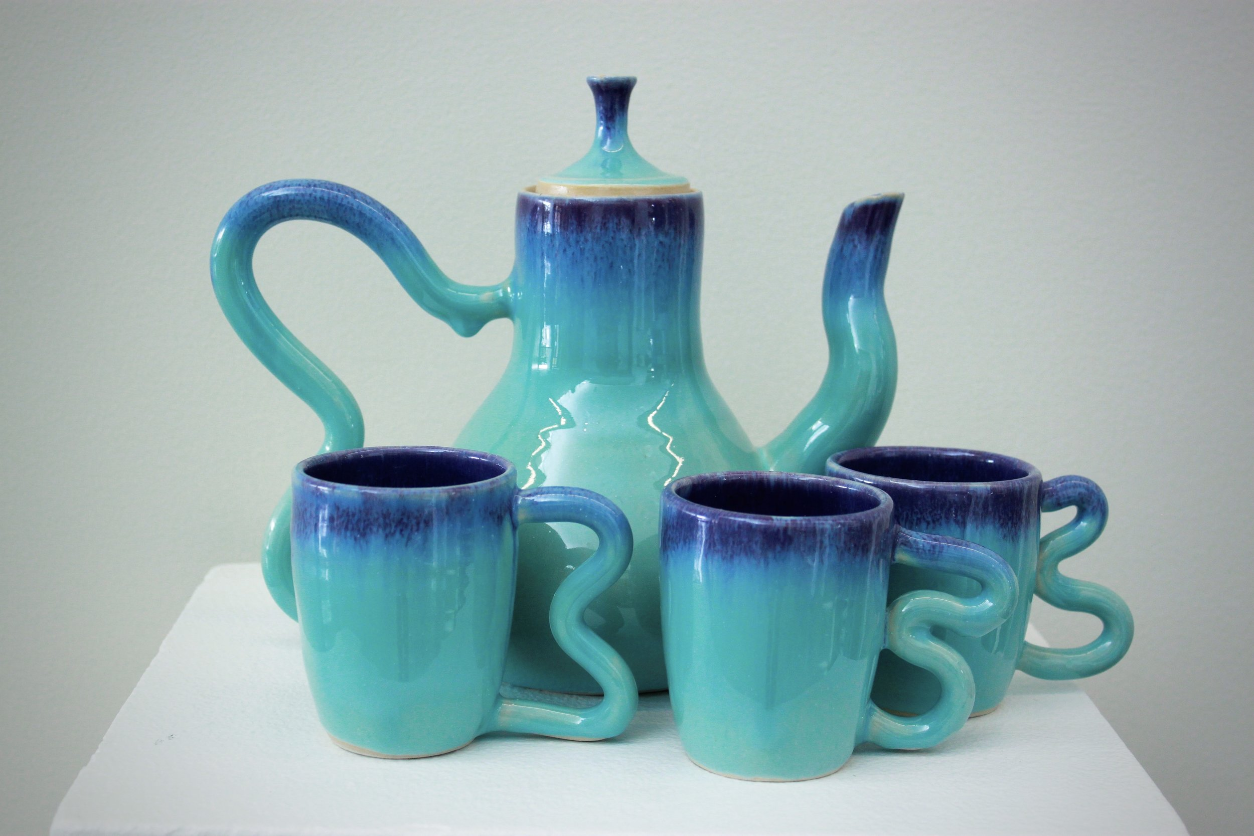 Topsy Turvy Teapot. Wheel thrown teapot with 3 matching cups. Approx. 12 inches.