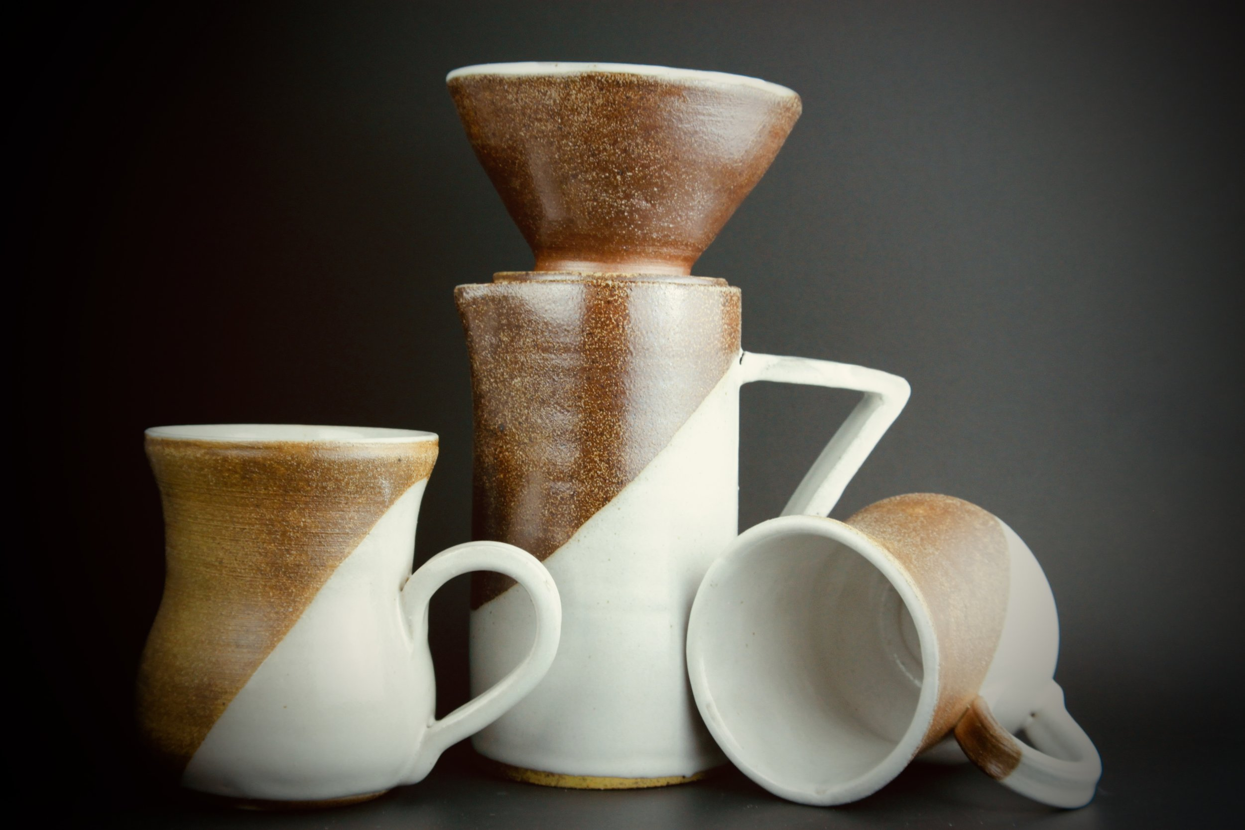 Coffee Carafe and matching set of mugs. Approx. 12 inches. Salt fired.