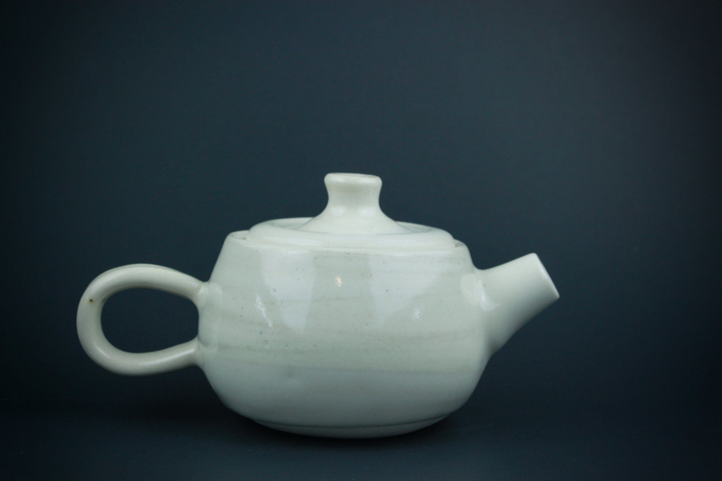 Dimple: Wheel thrown teapot. Approx. 4.5 inches.