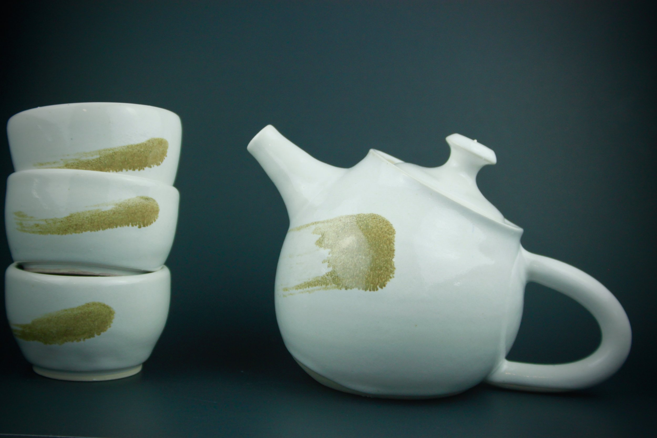 Sassafrass: Wheel thrown teapot with 3 matching cups. Approx. 6 inches.