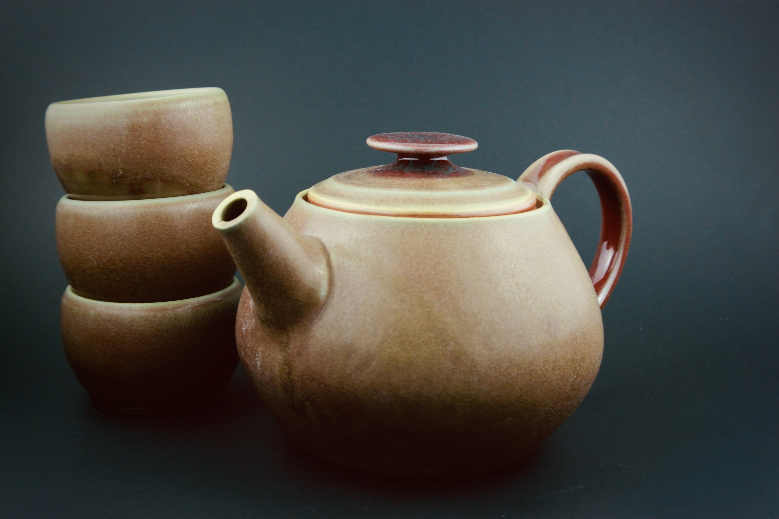 Kettle: Wheel thrown teapot with 3 matching cups. Approx. 8 inches.