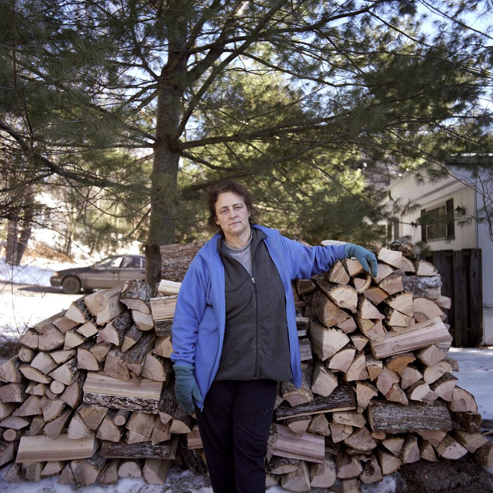 Carla and Wood Pile.jpg