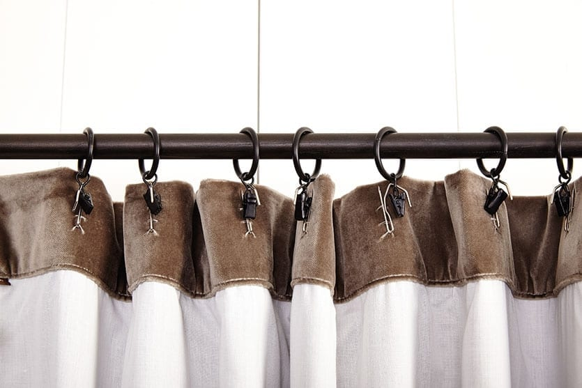 This shows the rings with alternate clips, which are not usually there if using drapery pins to hang your curtains.