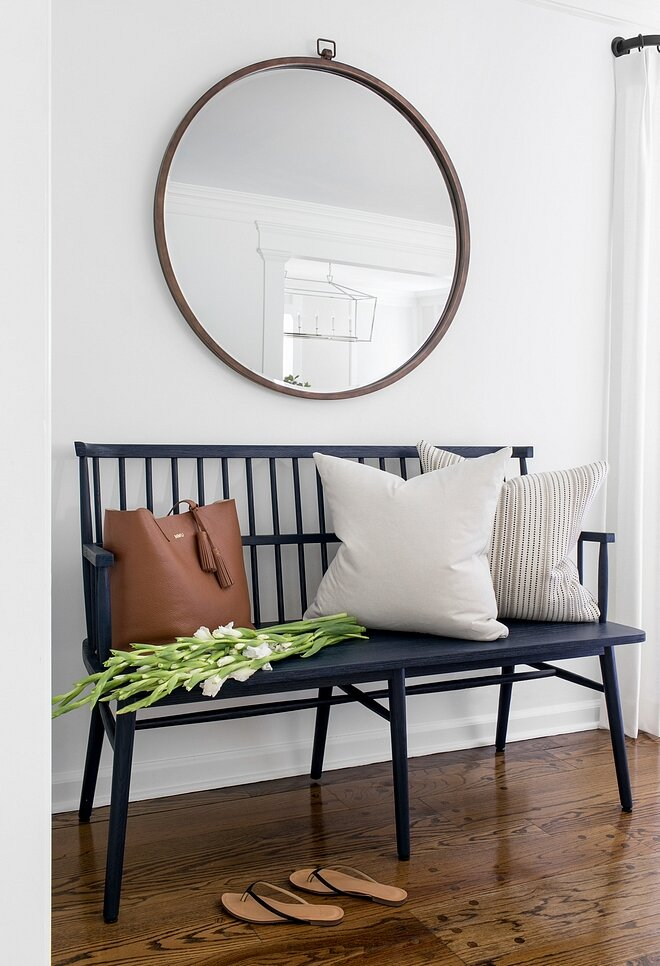 The Windsor style spindle-back bench is a timeless classic. Design by Ursino Interiors.