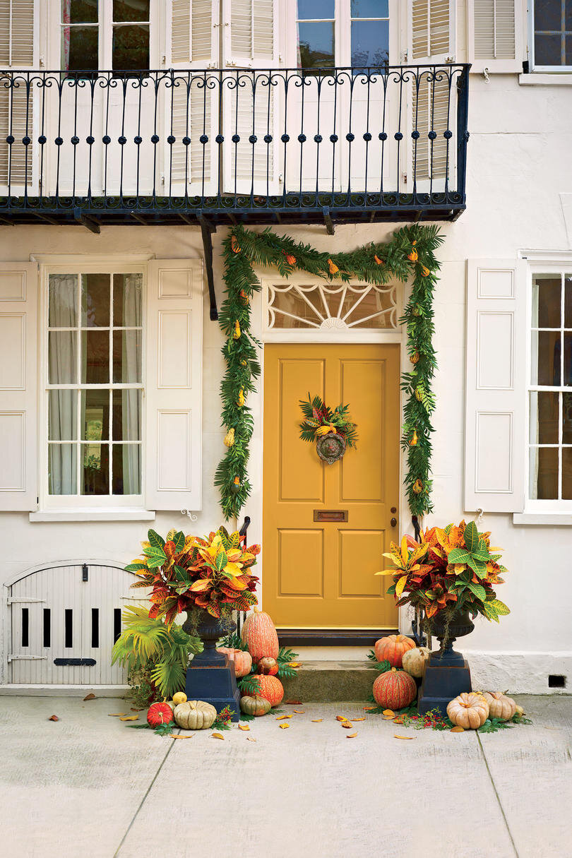 Technically a little closer to a swag than a wreath, but this colorful stoop vignette it certainly hypes the Autumn in a locale that's probably at least as hot as it is here! The colorful crotons, which wouldn't keep for very long in the Fall outside the Deep South, are perfect for this Low Country home. Also, the yellow door? YES. …Photo via Southern Living by Heather Barrie. Photo by Helen Norman.