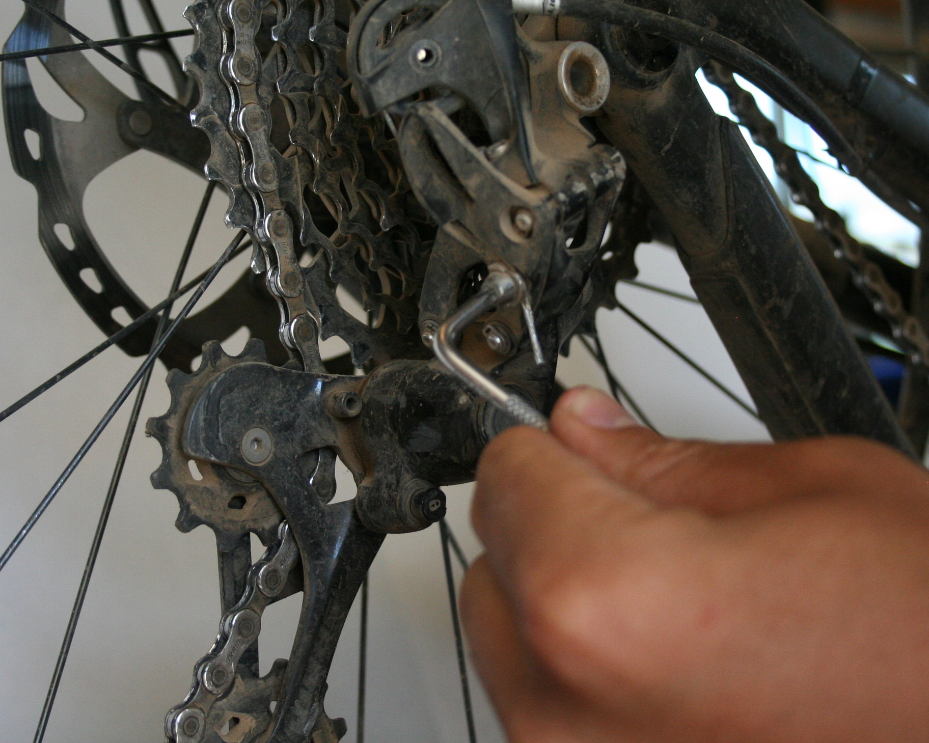 1. Remove derailleur cable - Loosen the bolt on the derailleur that holds the shift cable in place. If the end of the cable is frayed, you should consider replacing the cable as it will make the rest of the installation easier.