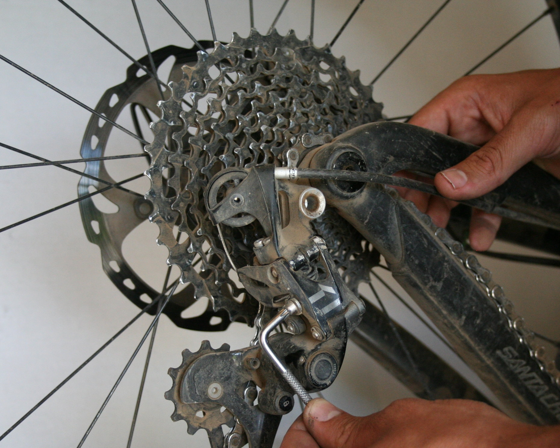 9. Reattach cable to derailleur - Grab the end of the inner wire where it comes out the back by the derailleur and pull on it to make sure all the slack is out, and then reattach the cable to the derailleur.
