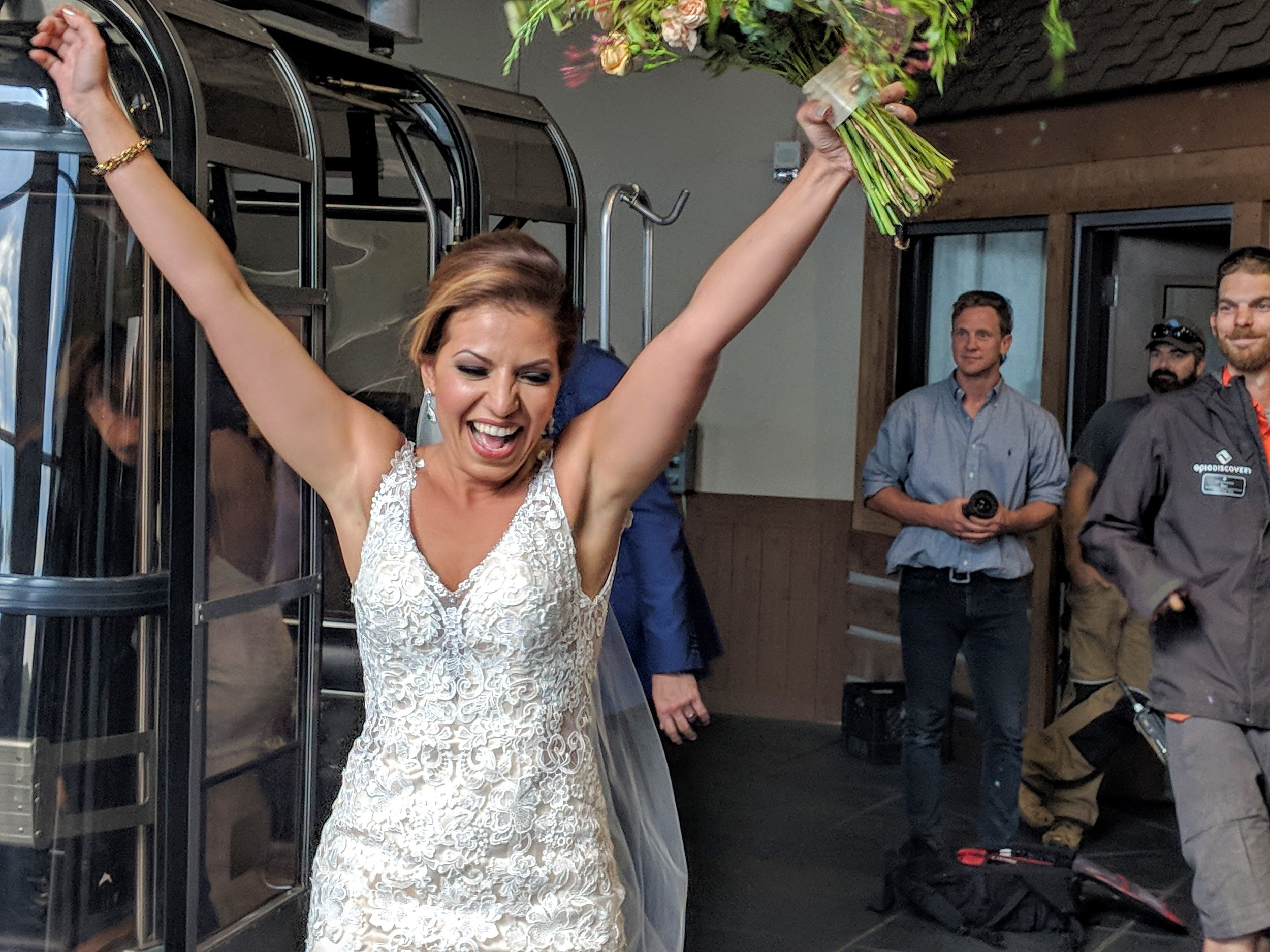 A bride celebrates when the Vail Wedding Deck gondola reopens after a thunderstorm