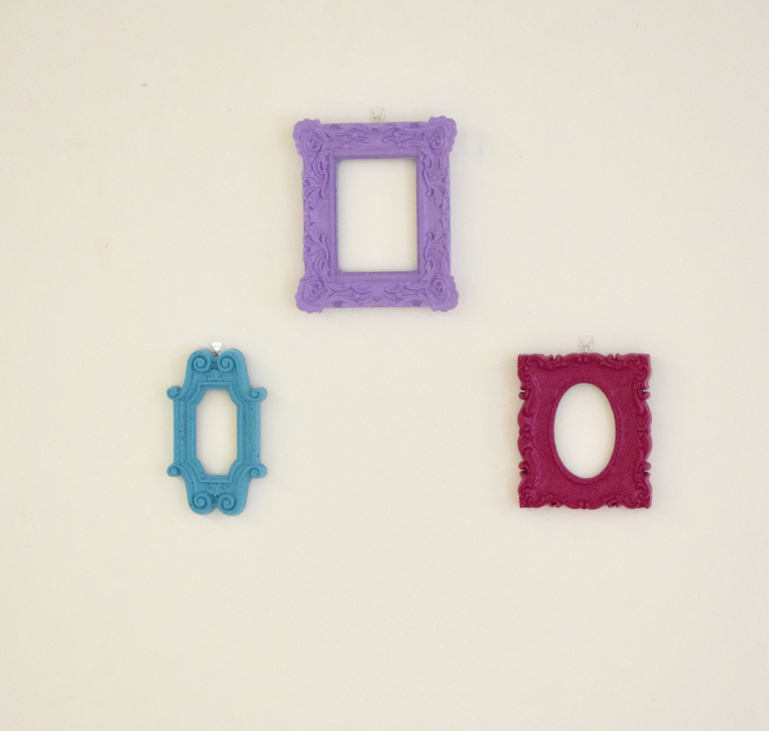 Another easy DIY is painting bright picture frames. Look for lightweight, decorative frames and paint to match your color scheme. We chose three main colors and used  Command strips  so that we could put them where we wanted and also remove them easily afterward.