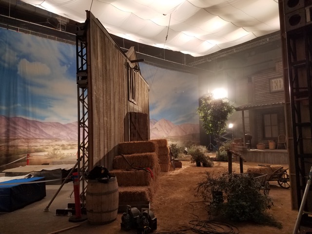 Hand painted 30'x70' muslin backdrop installed on set