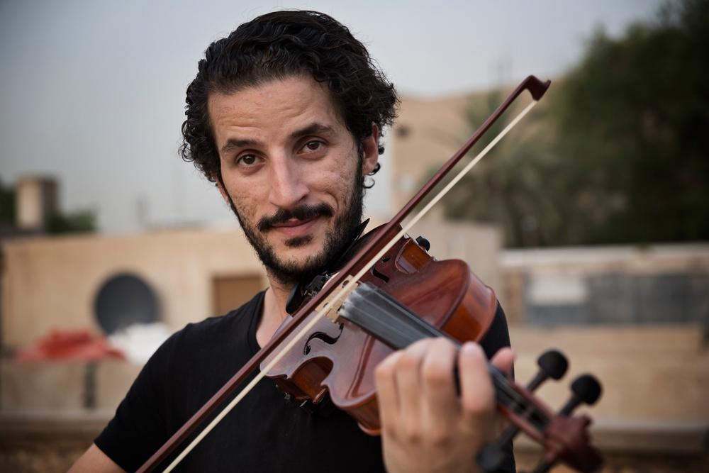 Ameen Mokdad   He plays many different instruments and also composes his own music. He is from Mosul in northern Iraq and when the city was occupied by militants from the so-called Islamic State Group in 2014, he played his cello on the roof in defiance of their occupation, despite the risk.
