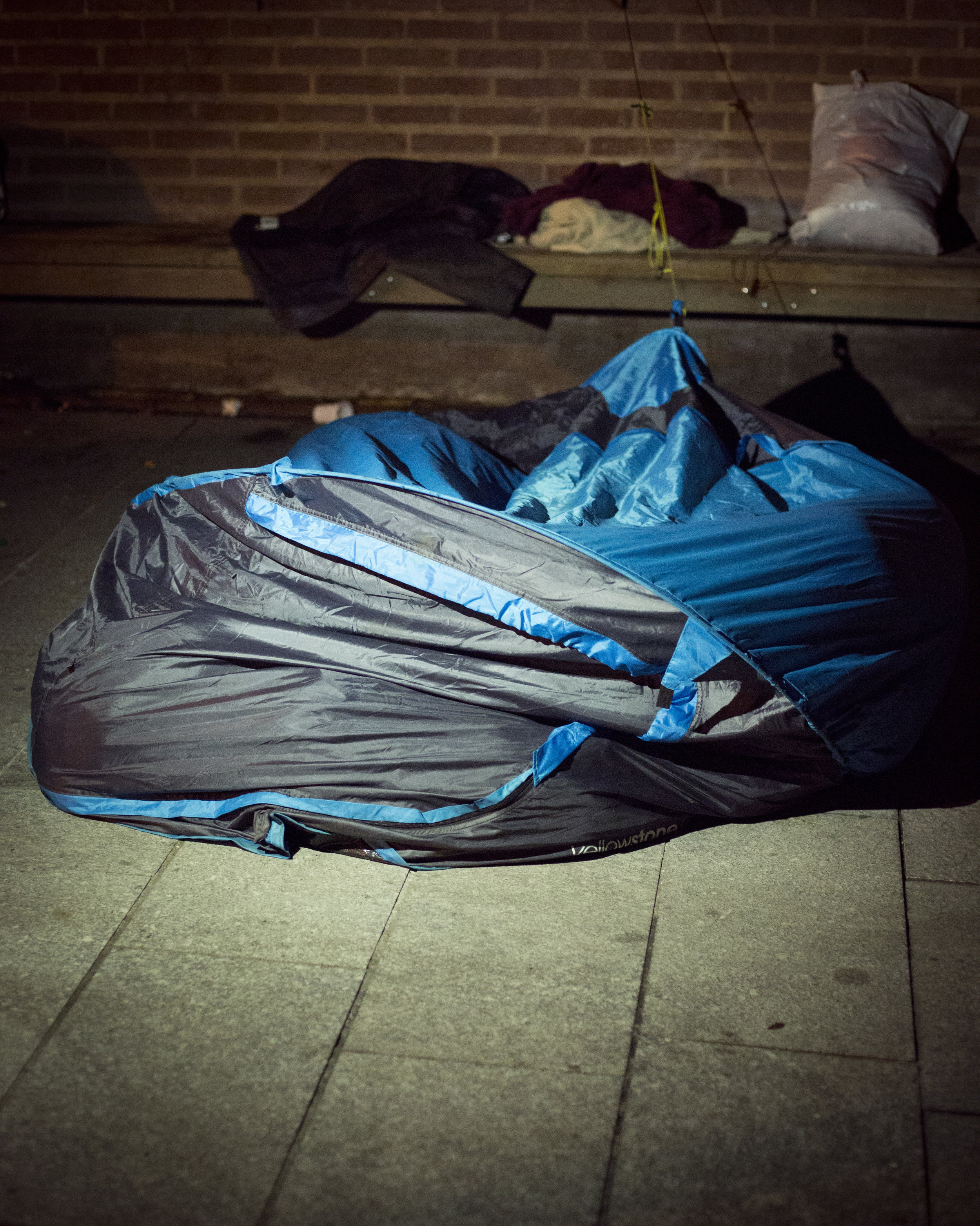 Two Men Sleeping in a Crushed Tent, St. Denis, France || For The New York Times