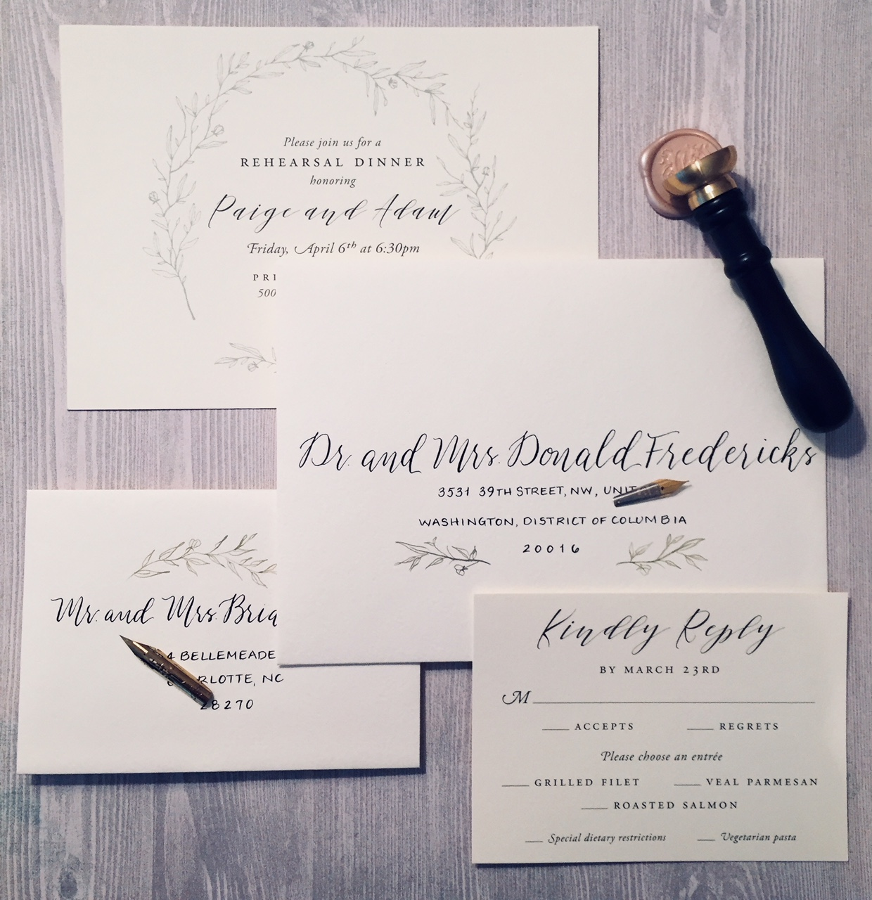 Pretty engagement party invitations with hand lettered envelopes with added vine to match the invitations
