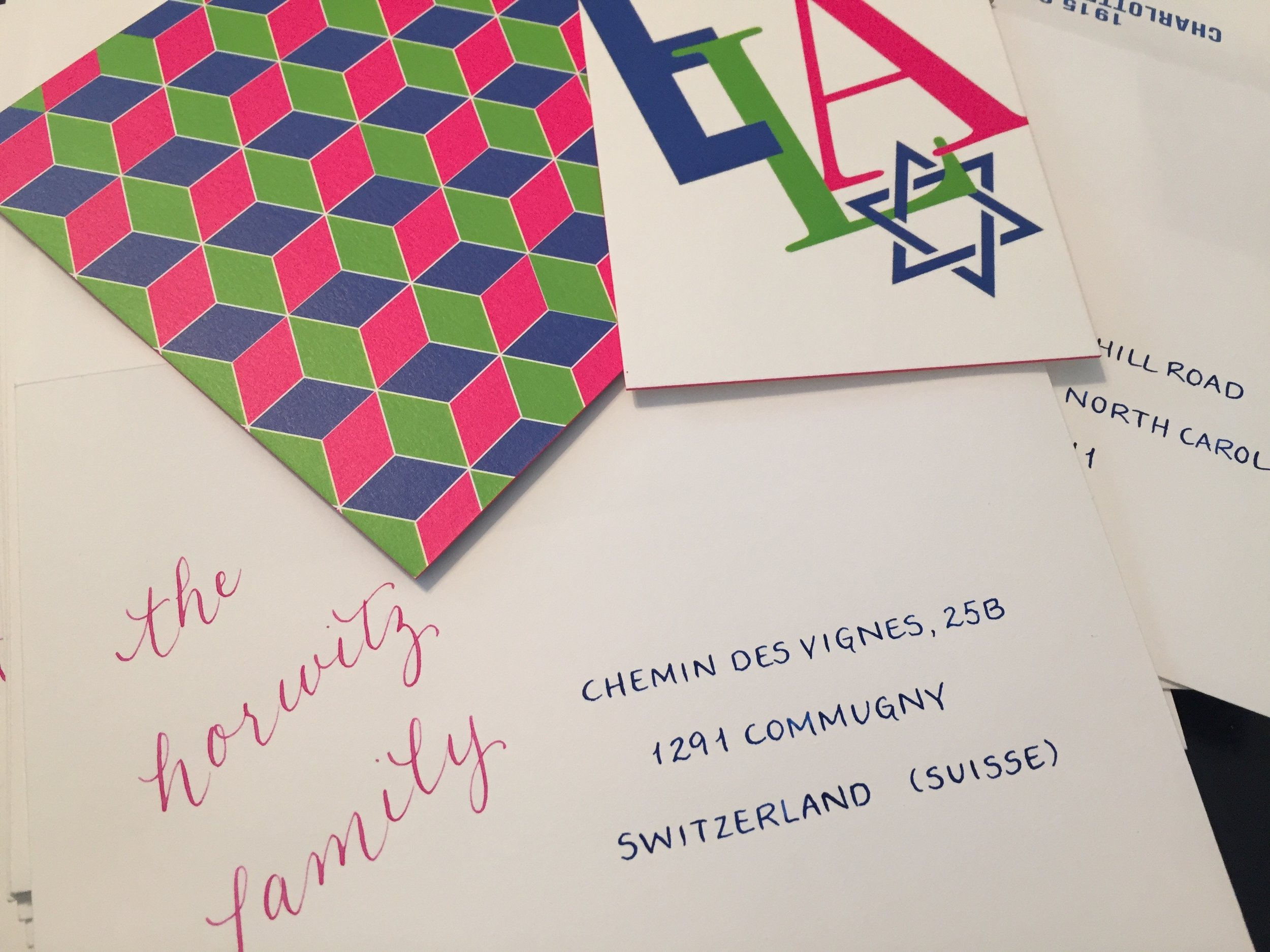 Fun mixed lettering with two colors to match the envelope liners for a b'nai mitzvah (triplets!)
