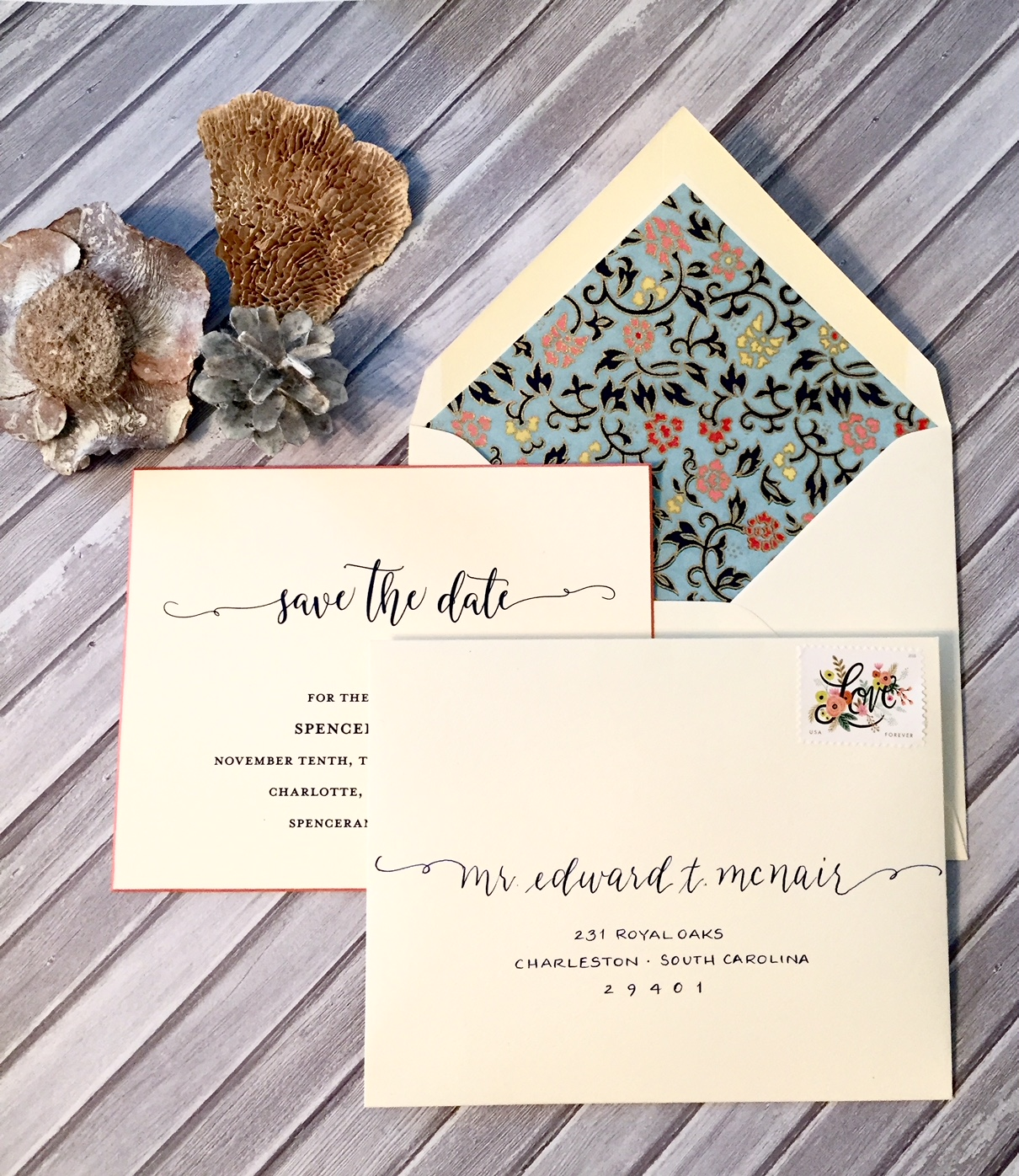 Save the dates written in a style to match the printed invitation in navy ink