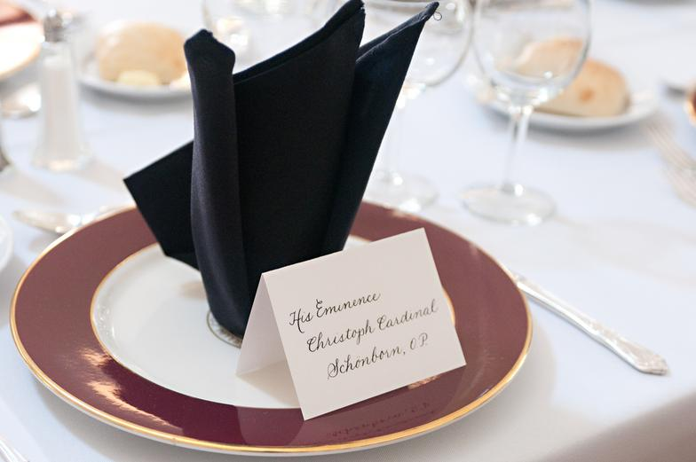 Place cards for a fundraiser for Belmont Abbey College