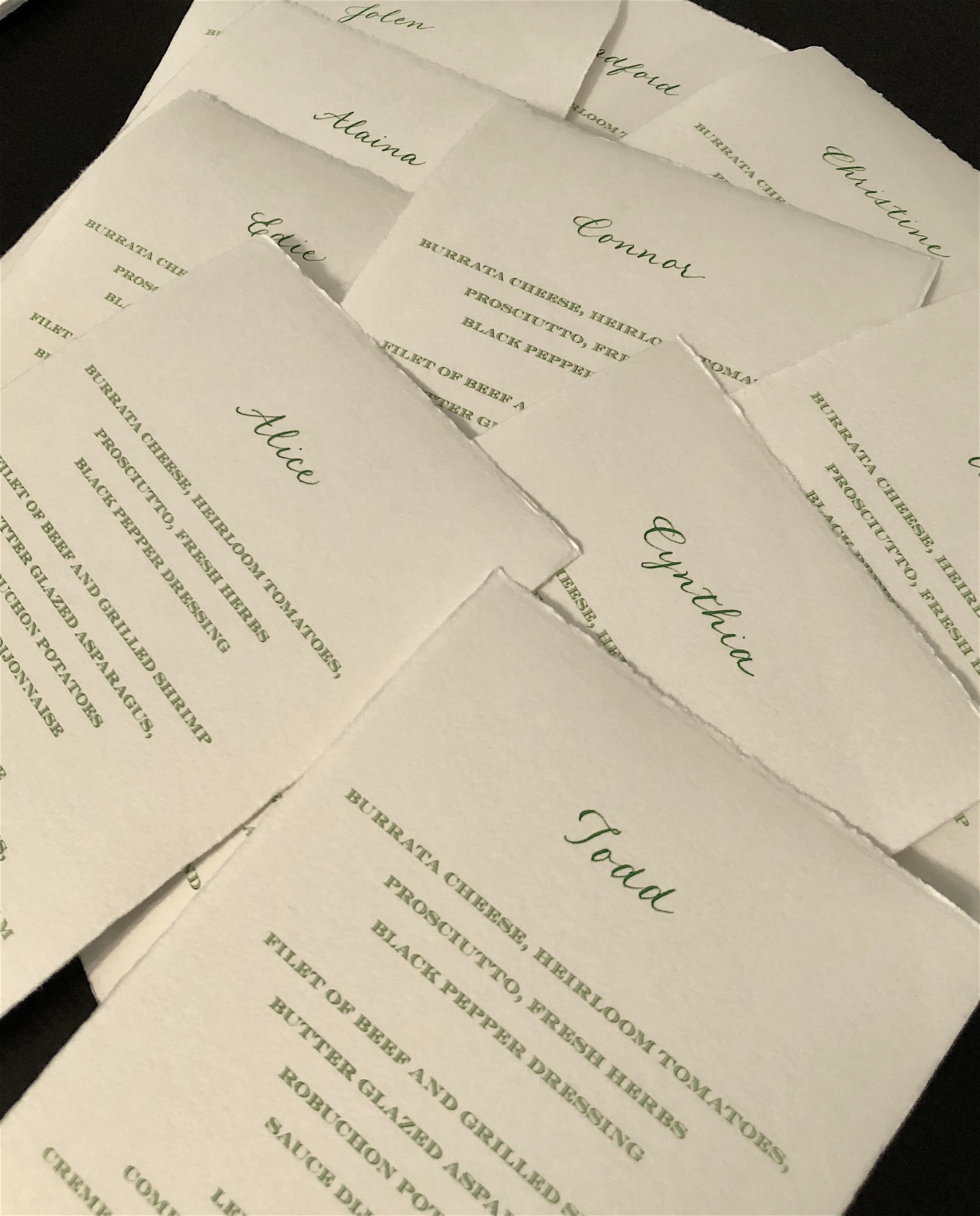 Menus on beautiful hand-deckled cotton paper with calligraphed names.