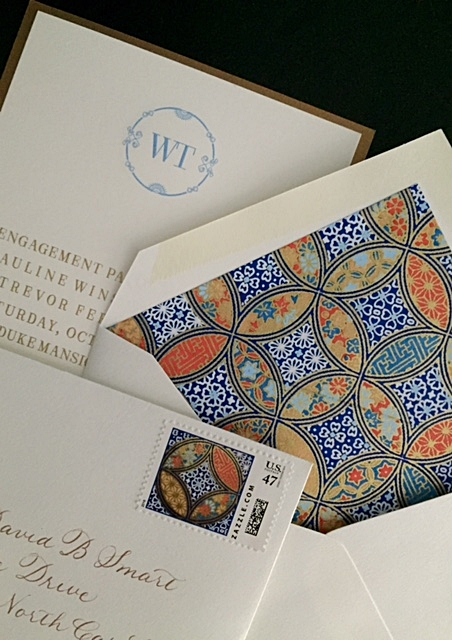 Gorgeous hand-lined envelopes with matching stamps with envelopes written in gold ink