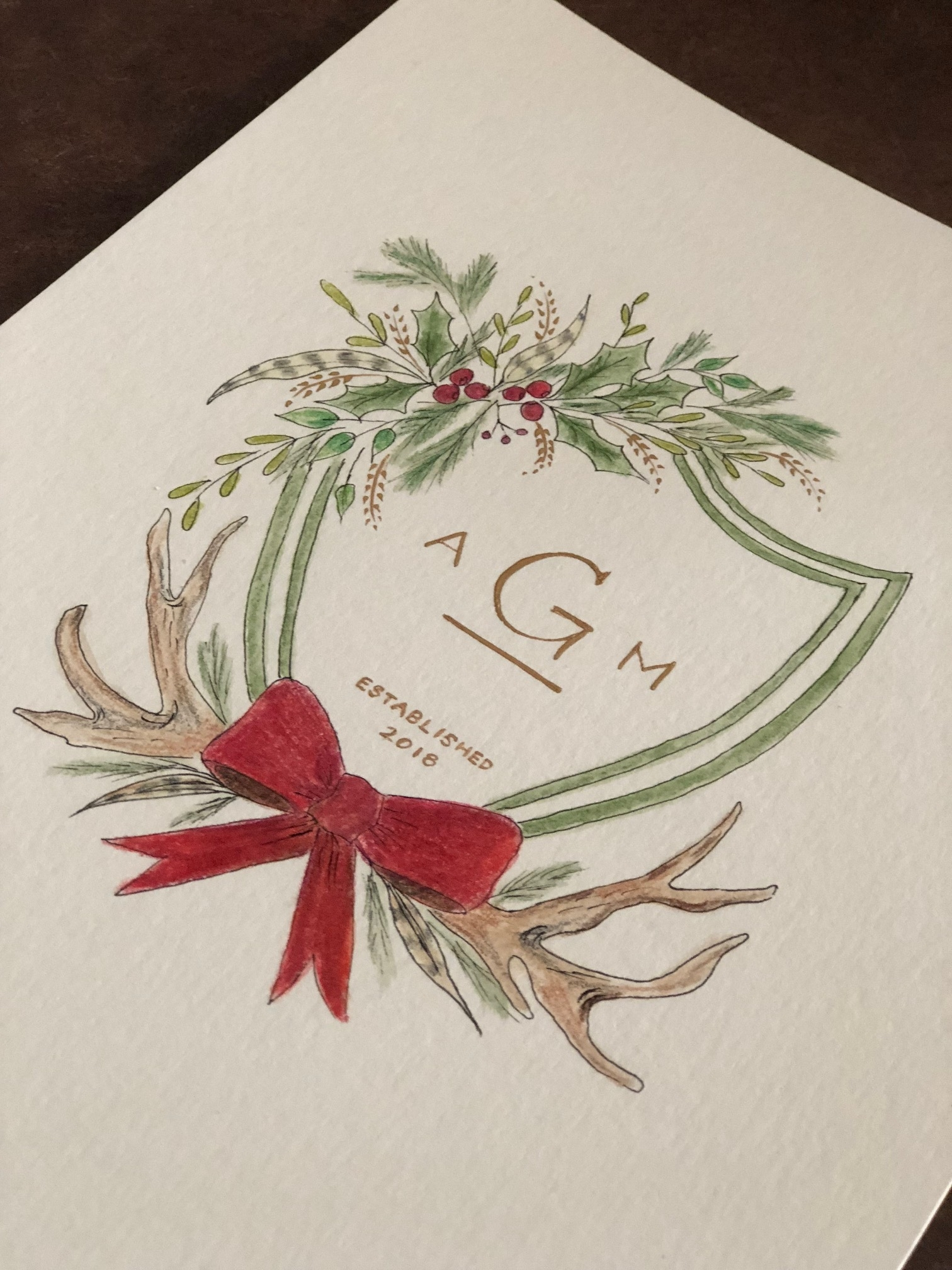 Custom watercolor family crest for a holiday wedding.