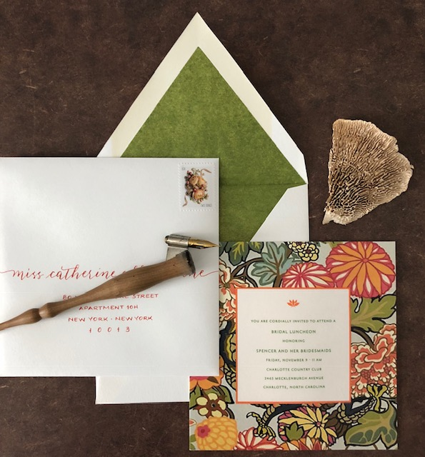 A stunning bridal luncheon invitation with custom-mixed ink for addresses.