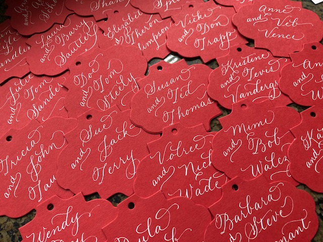 ornament die-cut tags ready to tie on to hand-delivered Christmas open house invitations.