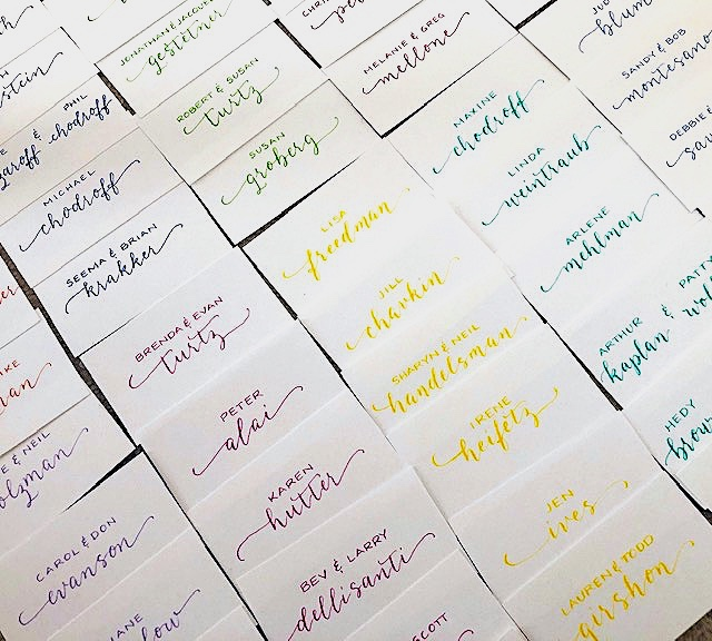 "Instead of table numbers, guests were ""color-coded"" instead at this fun bat mitzvah"