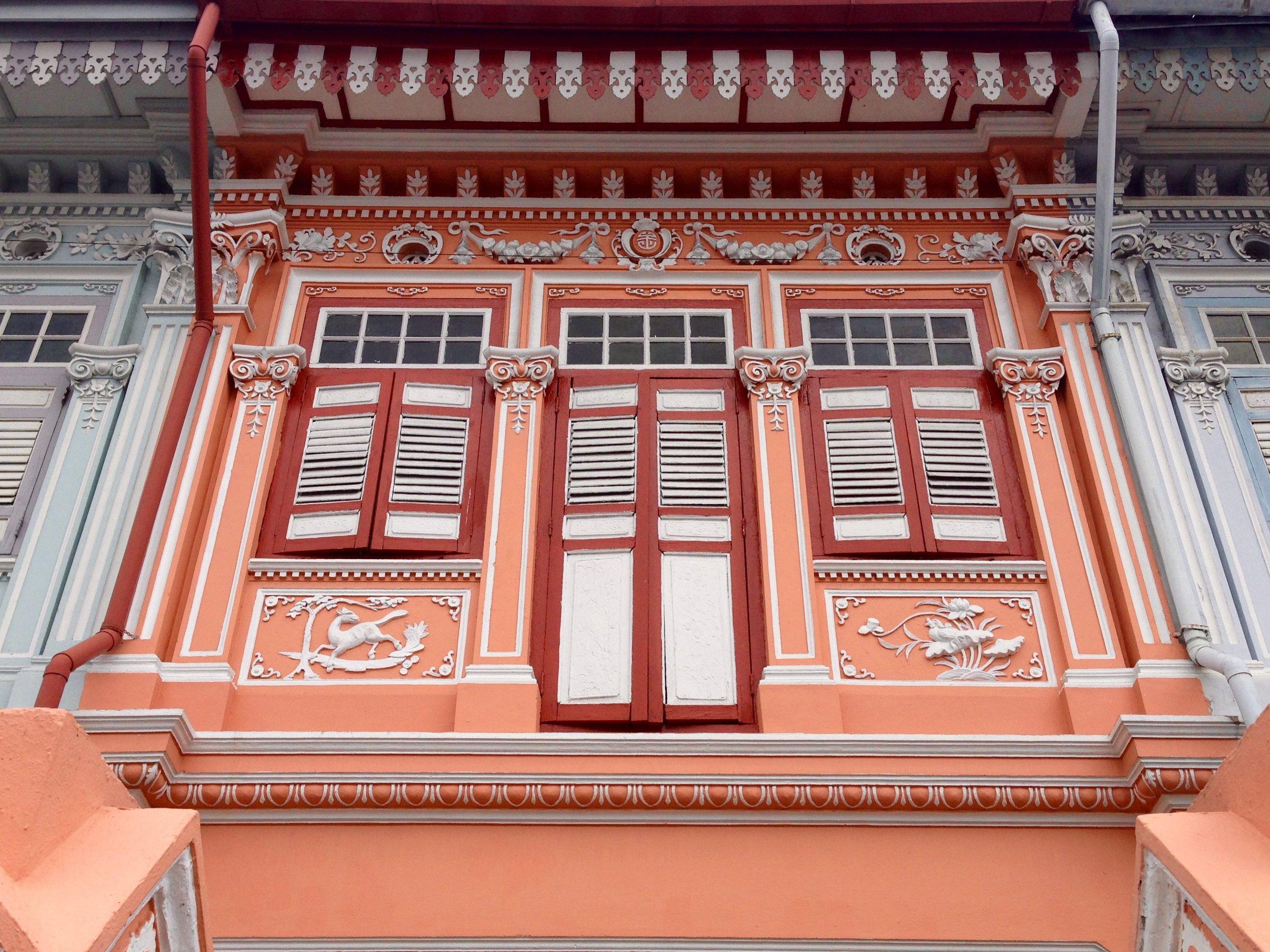 Exterior of a colourful Peranakan shophouse