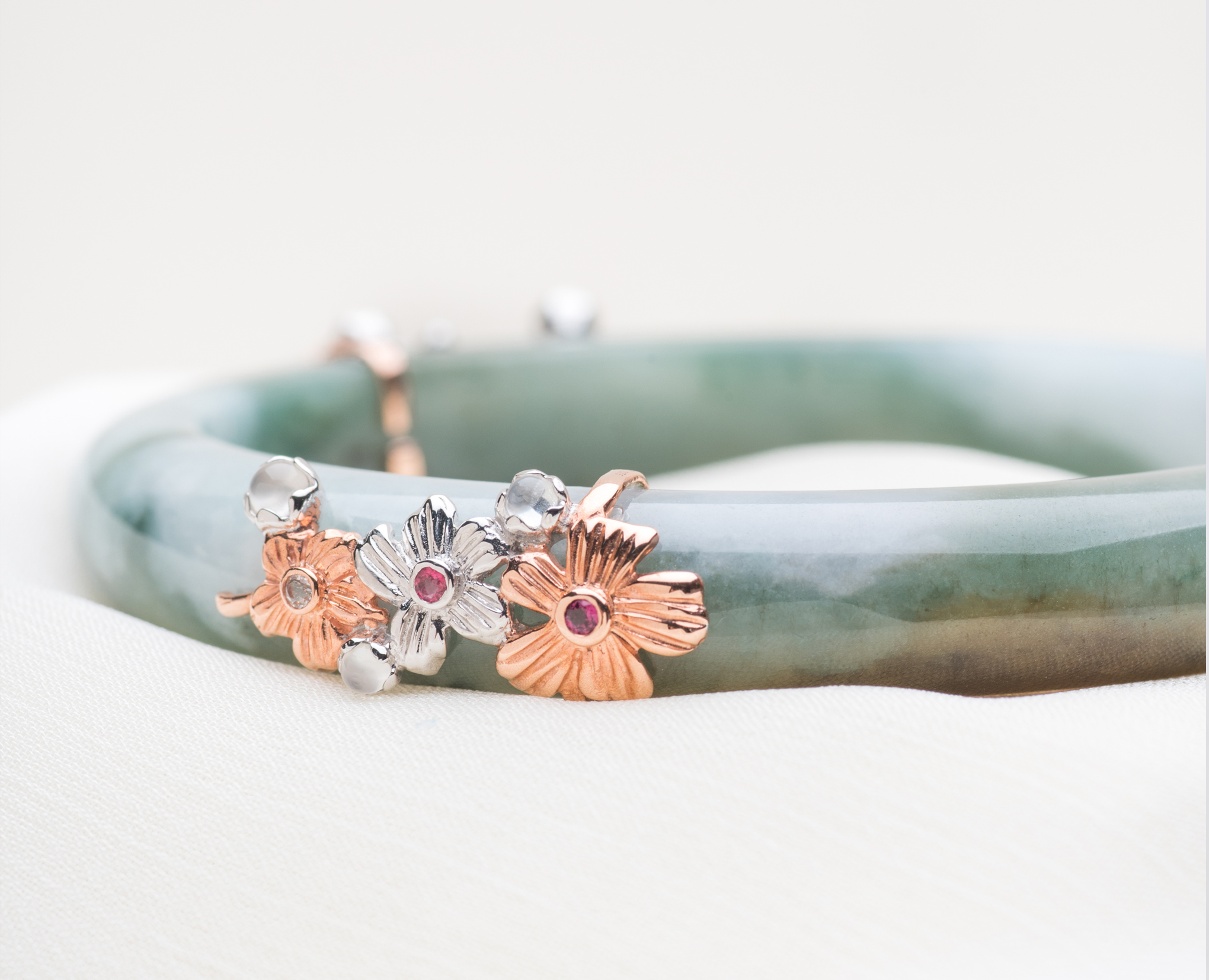 For Your Daughter - the one person you can't stop worrying aboutThroughout Asian history, jadeite has been a precious way to gift loved ones. Choo Yilin reinterprets traditional jade bangles into contemporary jewellery pieces that are versatile for important occasions and day-to-day wear. As jade jewellery is filled with heritage and meaning, they are wonderful as wedding gifts, and make beautiful heirloom jewellery pieces that can be passed down. Without a doubt, your daughter will treasure this Sakura Jade Bangle and perhaps even pass it down to her own daughter in the future.
