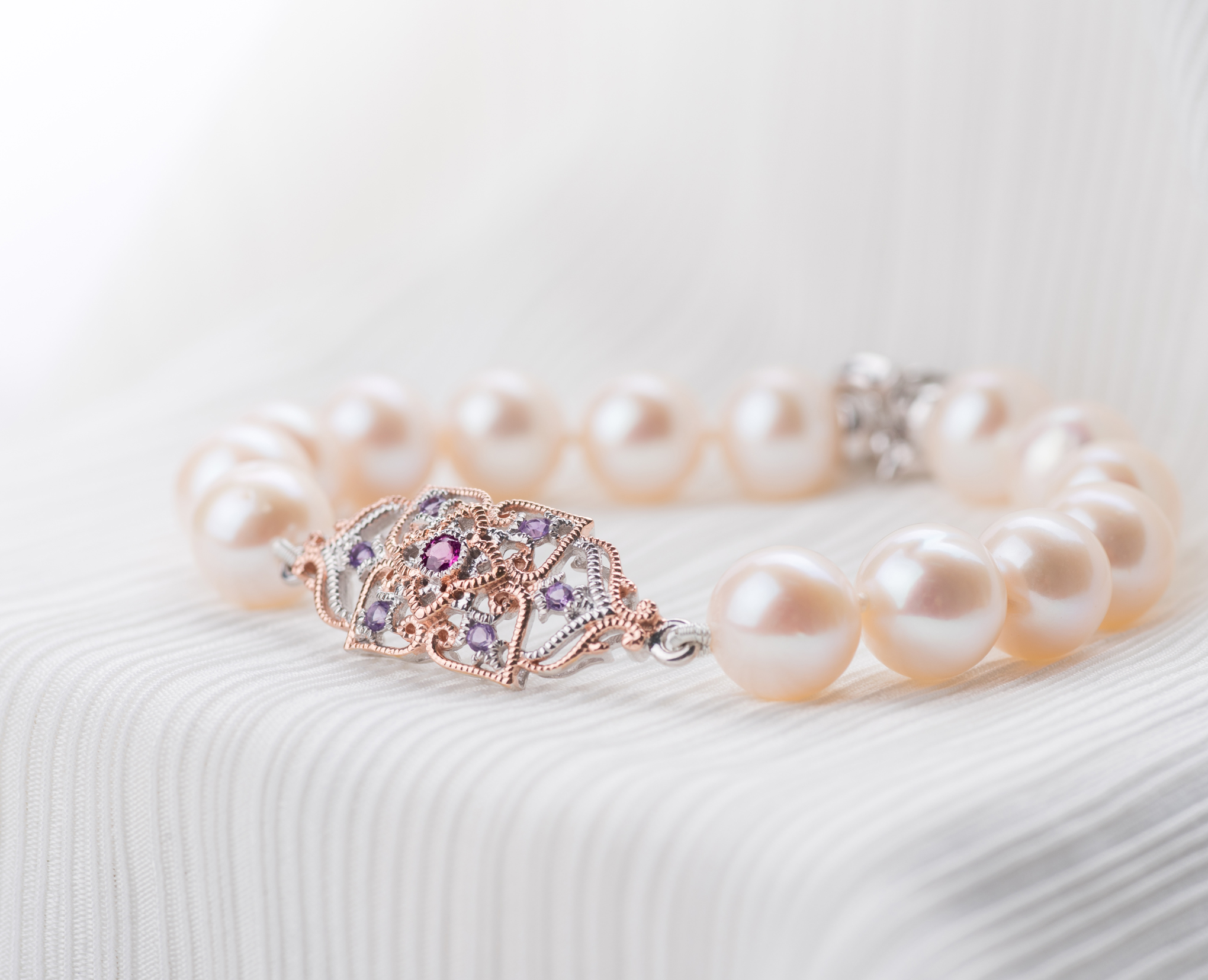 For Your Best Friend - the one who's seen the best and worst of youRemember the friendship bands you used to exchange with your best friend? As precious as those bands were, there's nothing quite like a string of pearls to strengthen your friendship and to thank her for always being there through thick and thin. After all, pearls are symbols of purity, innocence and love - virtues of great friendships that go a long way back. Featuring freshwater pearls, the Peranakan Lace Pearl Bracelet in 9KT solid gold is worthy of celebrating life's most special moments and people.