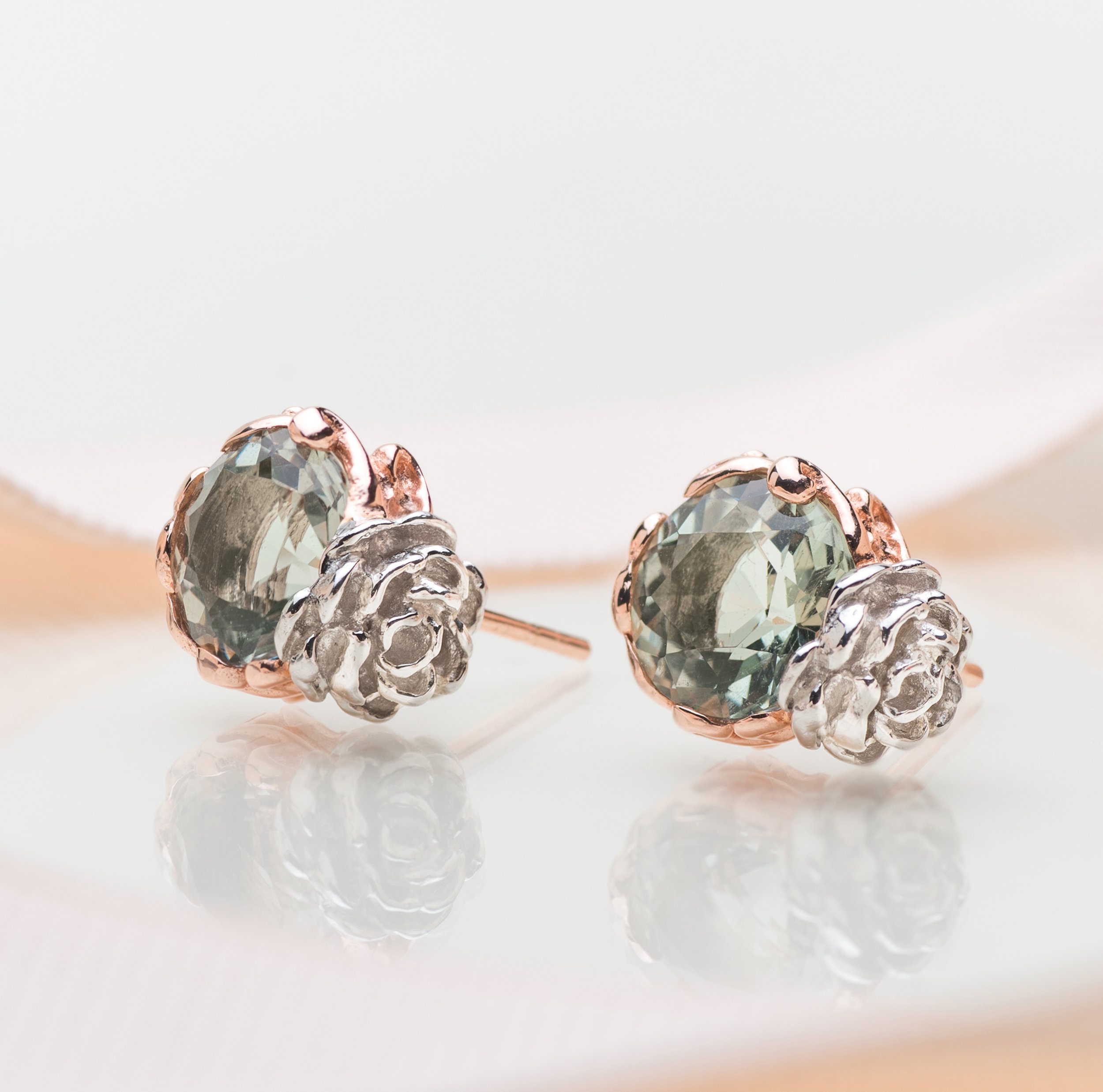 Green Amethyst: For Fortune - Green Amethyst is most popularly known as the stones of good fortune and luck. Whilst the soft soothing green hue is often enough reason to bring a smile to your face – the added symbolism of prosperity should only widen your grin.Don a pair of Flower Jade Studs in Green Amethyst and who knows - perhaps you'll find the winds of fortune swaying in your favour. It's the reinvented modern women's take on the traditional lucky penny or rabbit's foot. After all, there's really no such thing as too much luck.