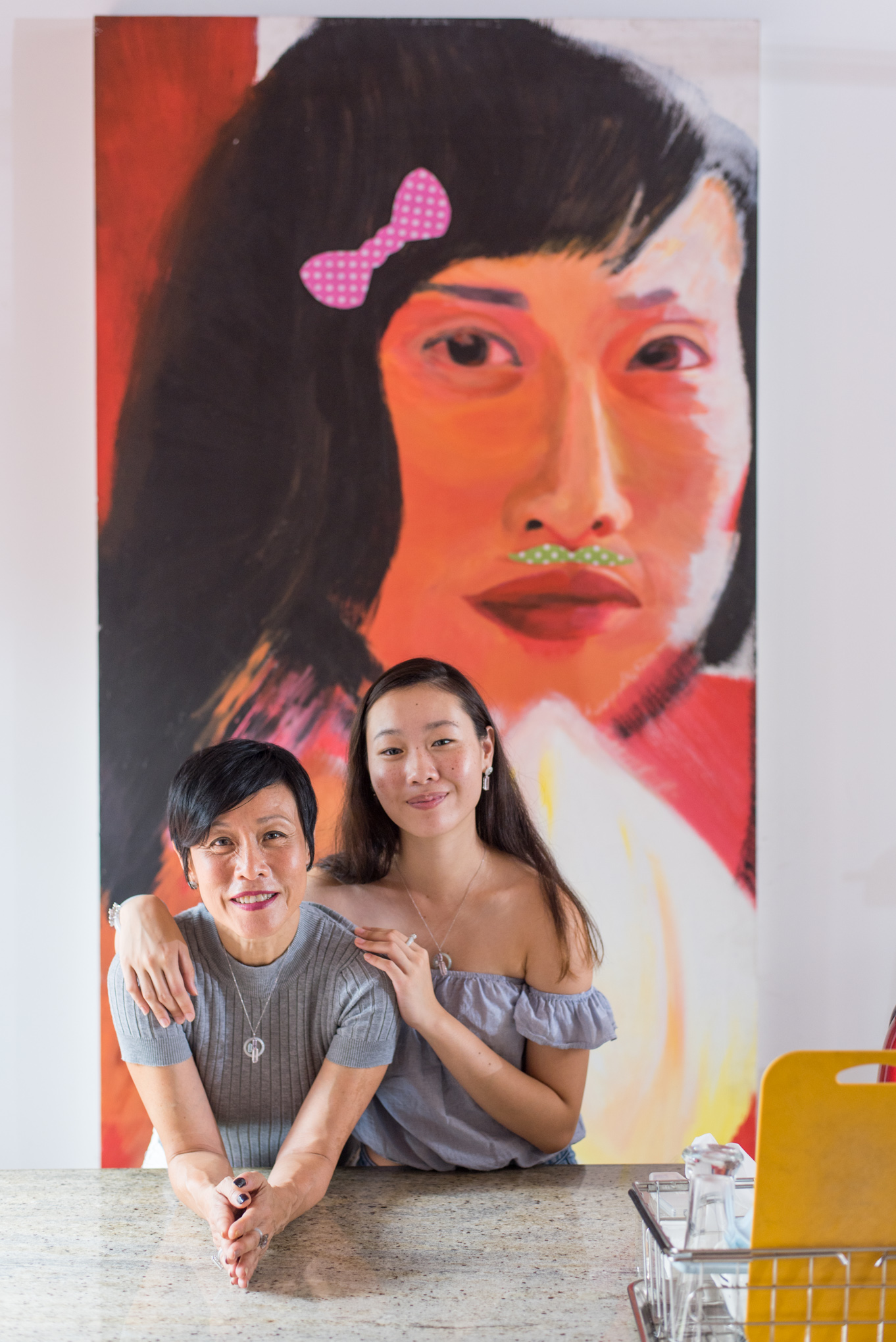 At the heart of any Choo Yilin narrative, is above all,love. - And with love comes the second instalment of Heritage Stories. We speak with Tan Kheng Hua: mother, veteran of Singapore theatre, award-winning actress and producer; and her spirited daughter, Lim Shi-An.Together, they welcome us into their most special space:Home.From the very first step into their Joo Chiat Shophouse, their abode spoke volumes of their expressive characters. Vibrant colours decked the walls, tasteful wood furniture projected a warmth throughout the space, and personal touches of portraits and trinkets offered us a glimpse into their shared passion for the Arts.. there is a story behind them all, and we are excited to share them with you today.