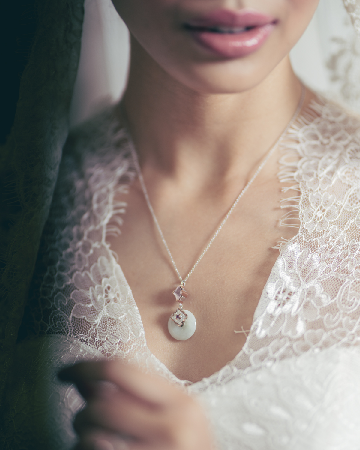 The bride wears Choo Yilin's Kebaya Jade Donut Necklace in solid gold, framed in silhouettes of delicate lace.