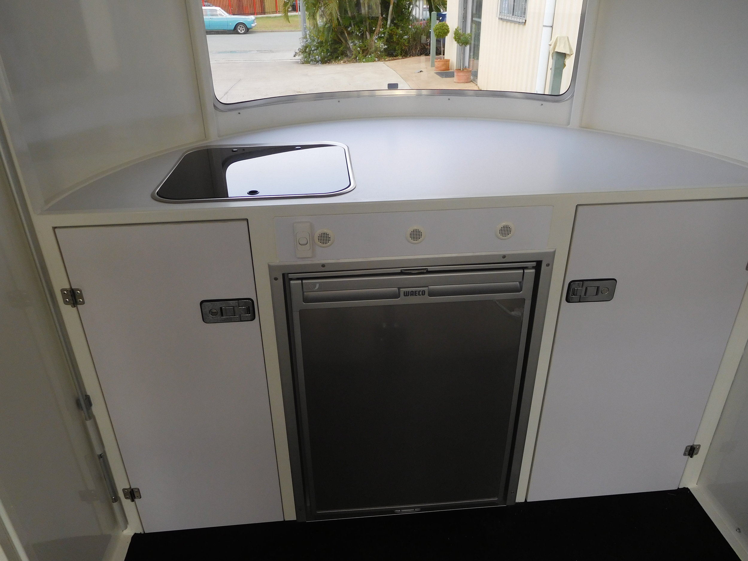 Pop out sink and 108 L Fridge