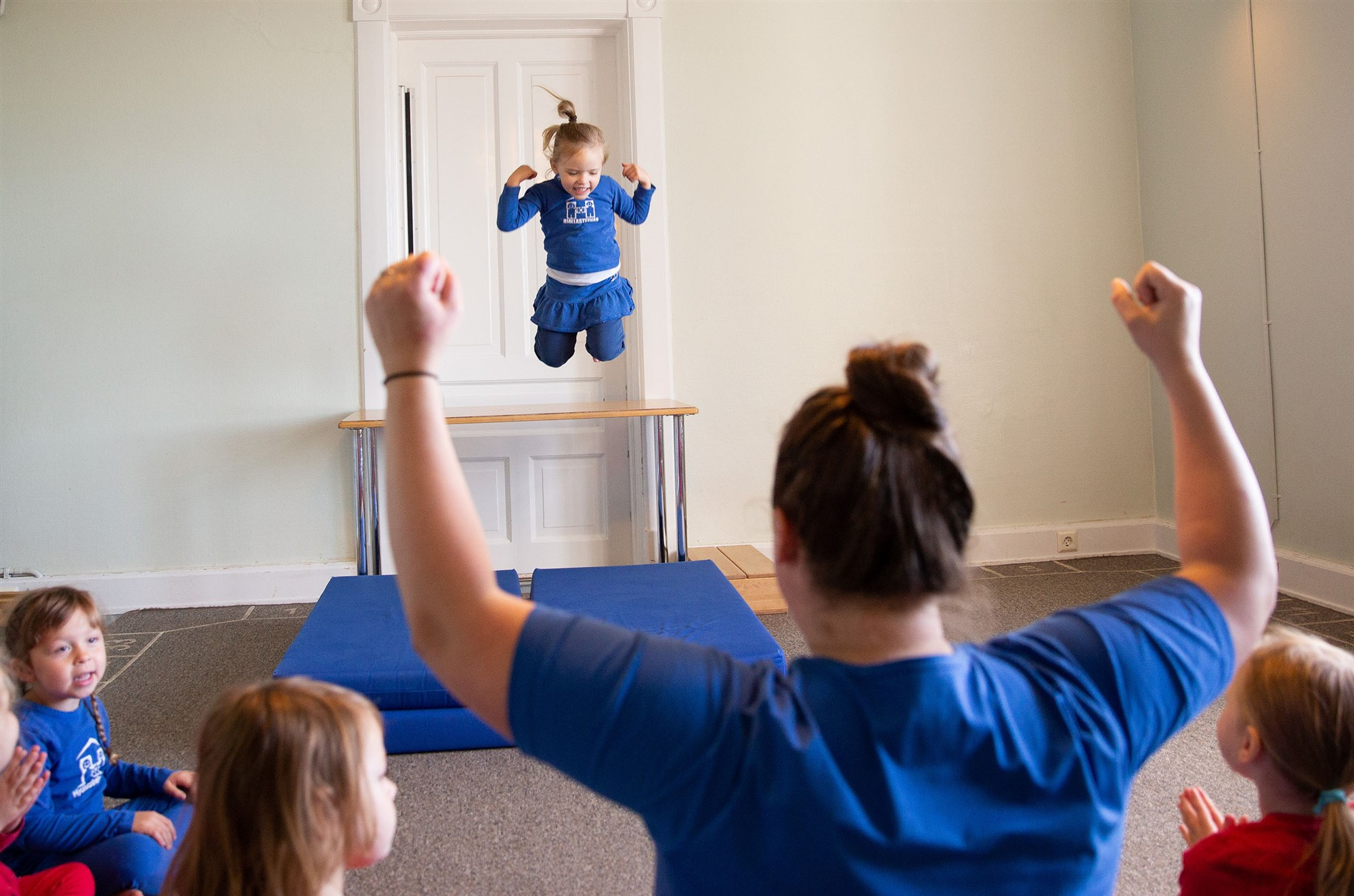 """A girl jumps off a table while shouting """"I am strong"""" at the Laufásborg kindergarten in Reykjavik, Iceland.Brynjar Gunnarsson / for NBC News"""