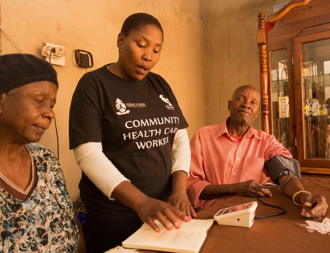A Tshwane CHW screens the health of an individual at home.