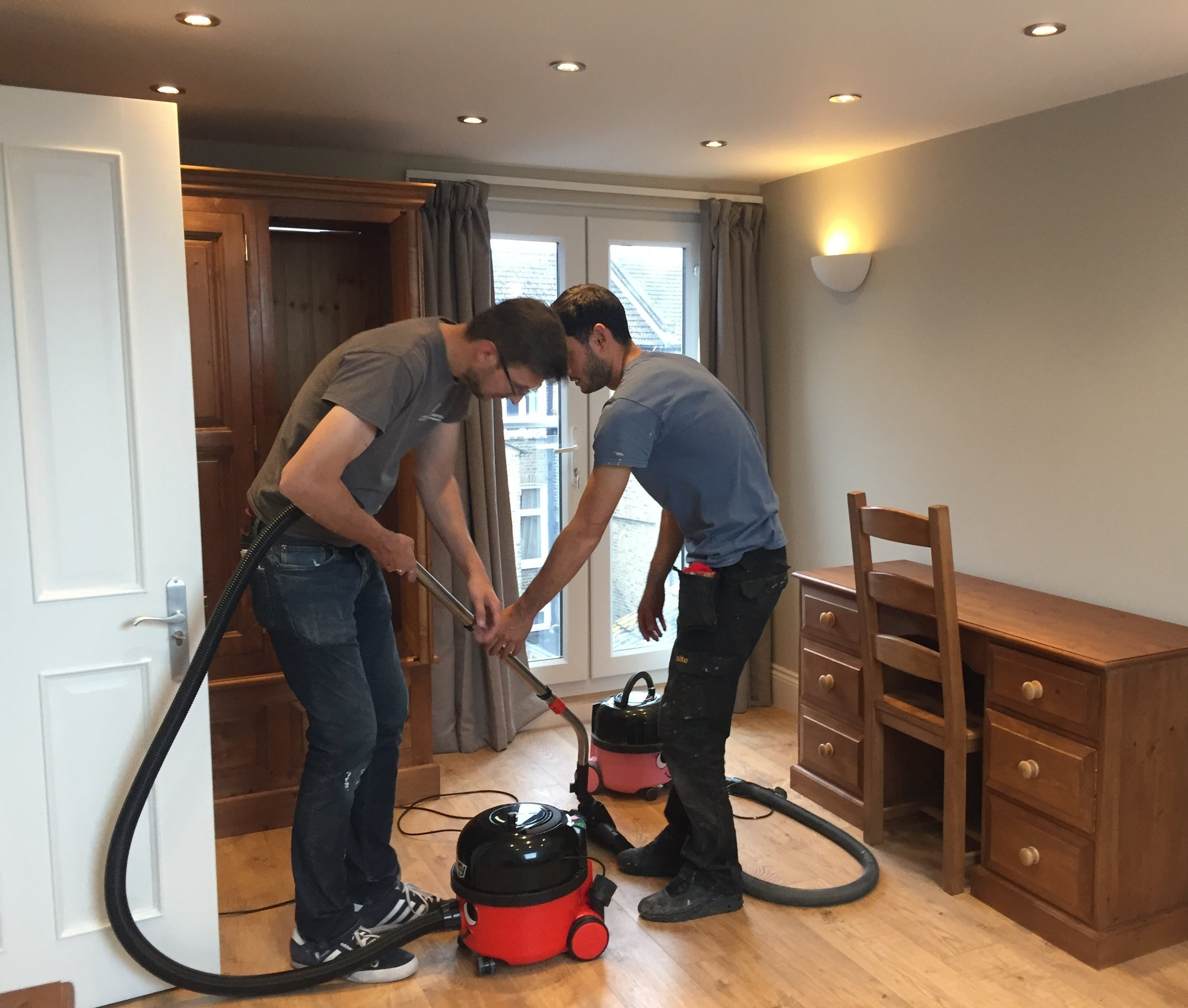 Matt and Atila readying a room for a new tenant