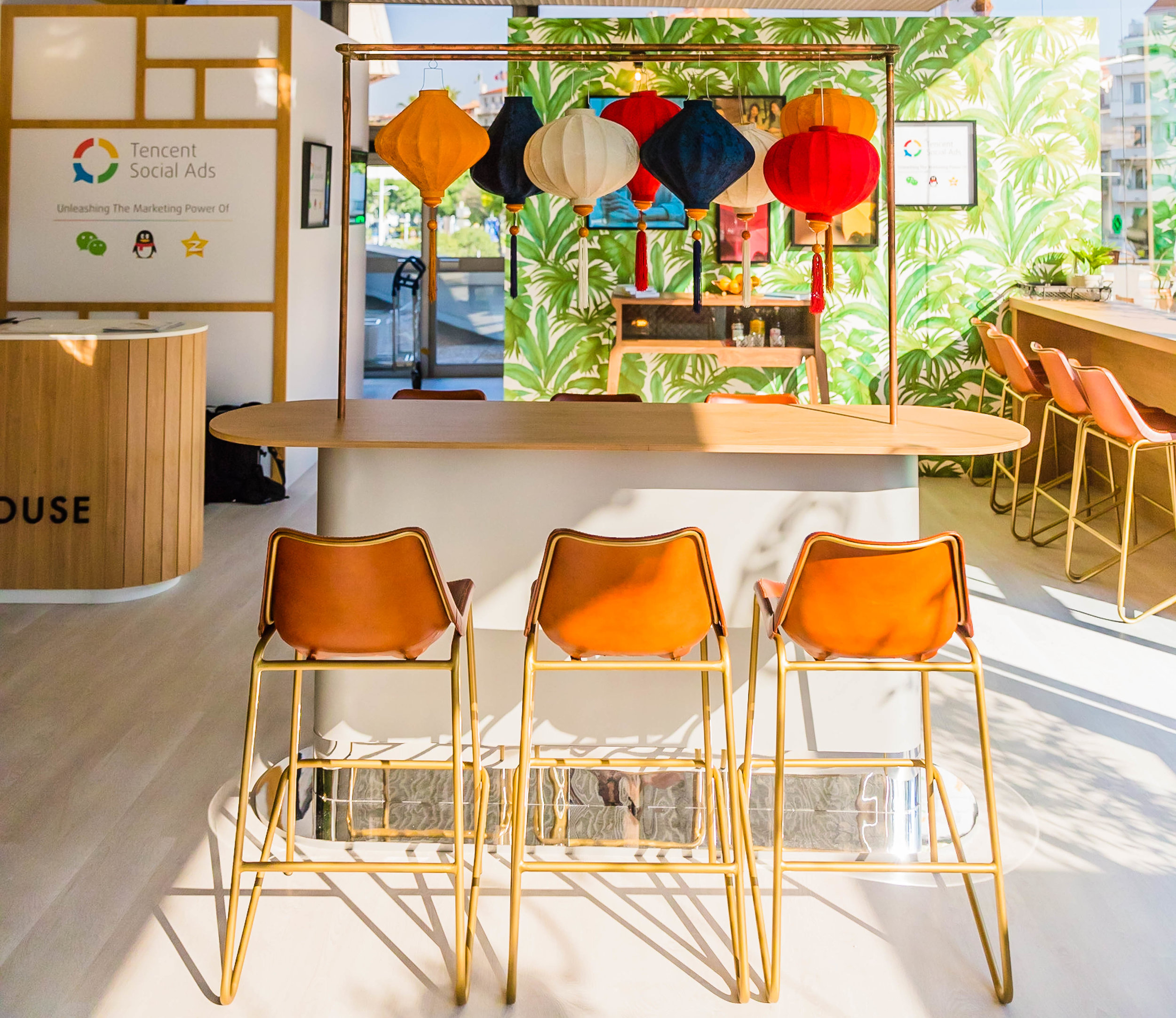High workbenches, reception desk and vintage whiskey cabinet for the Tencent CEO's lounge at Cannes Lions 2017