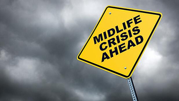 Yellow road sign saying mid life crisis