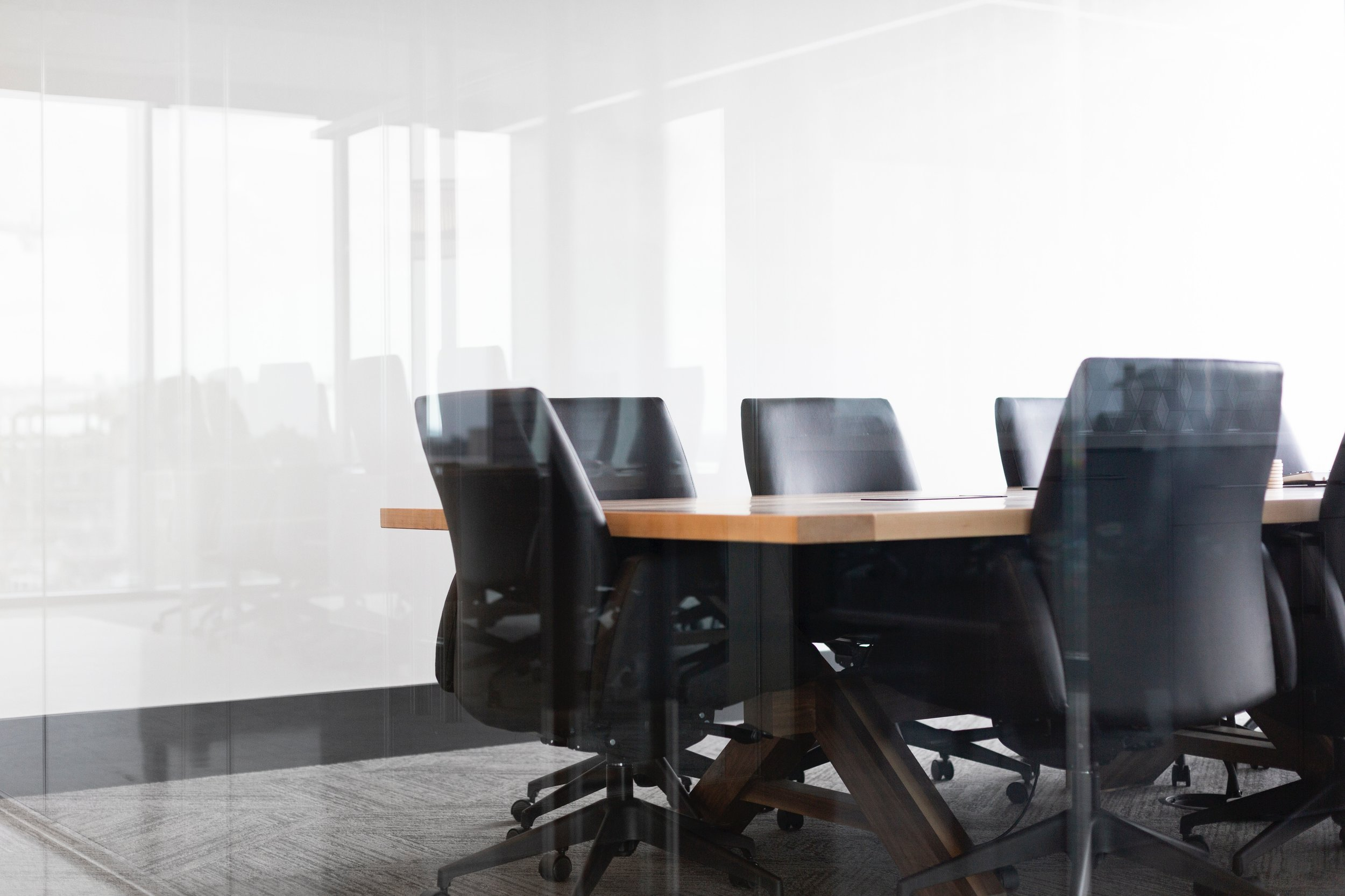 Boardroom with meeting chairs and table