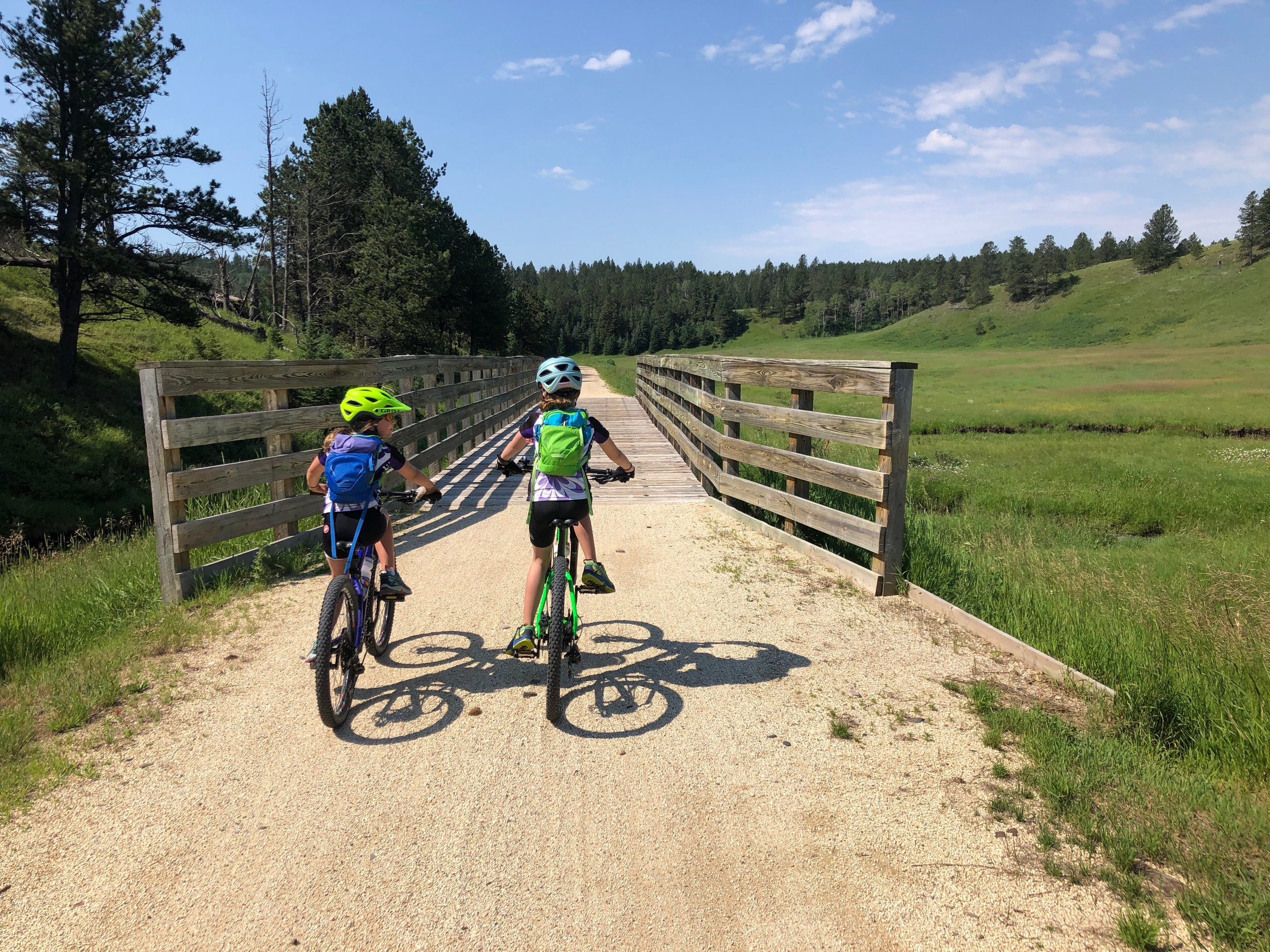 John and I spent a lot of the time riding with each of the girls, but we also got to ride side by side which gave us an opportunity to watch the girls chatting and enjoying themselves. Moments like these make my heart SING!!