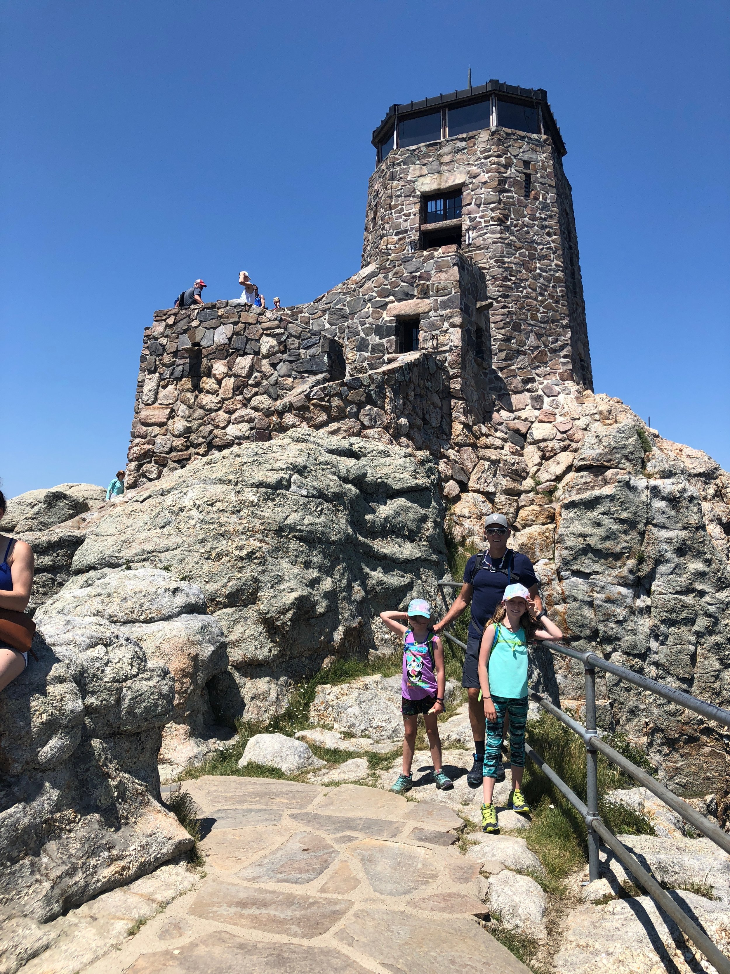 At the Top of Black Elk Peak, 7,244ft. This is an old fire tower that was pretty cool to check out. When we went up to the top level we all bent down so Isla was the tallest person in all of South Dakota for a few seconds!!!