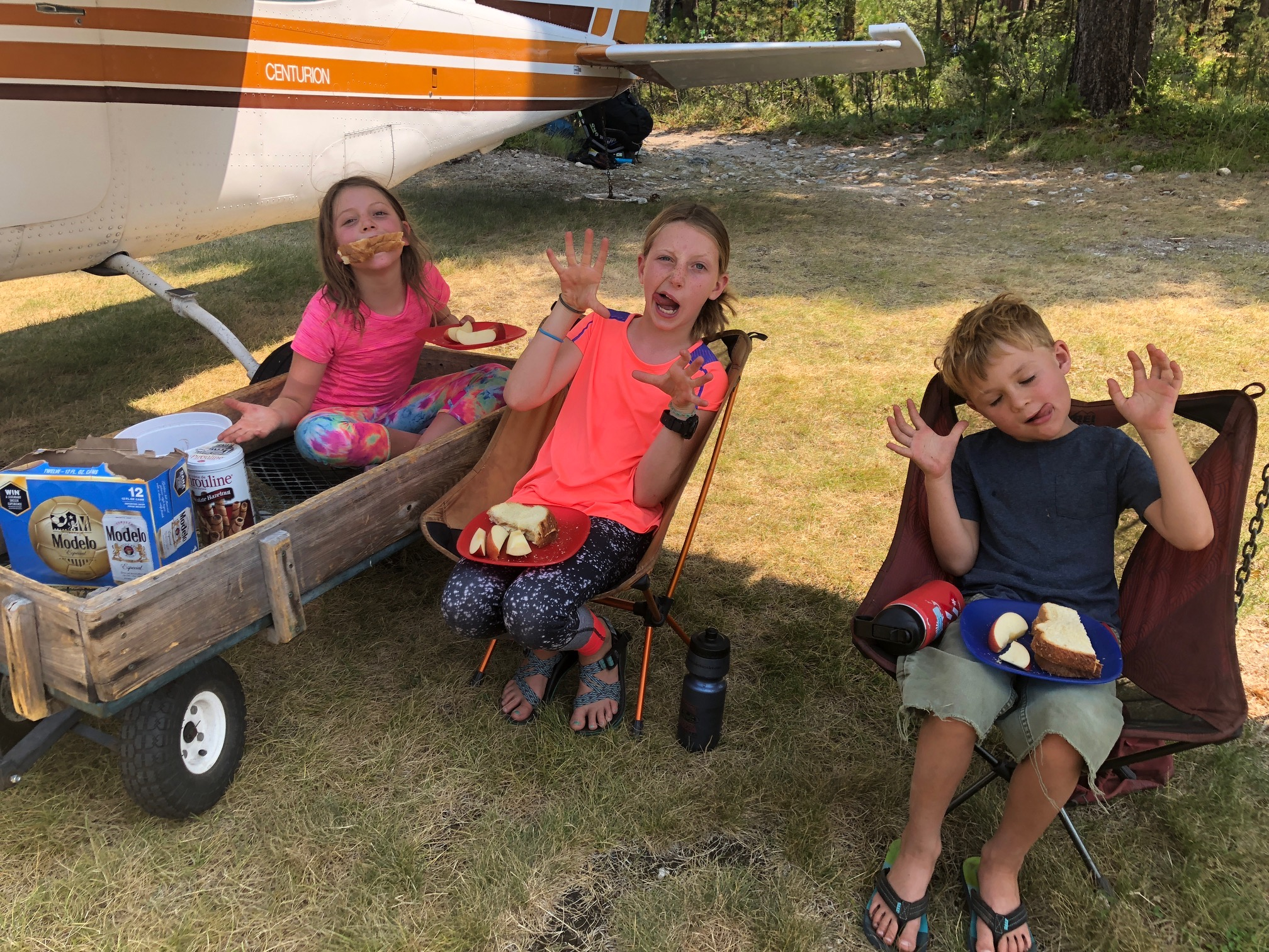 Being goofy while having lunch in the shade of the wing of the plane