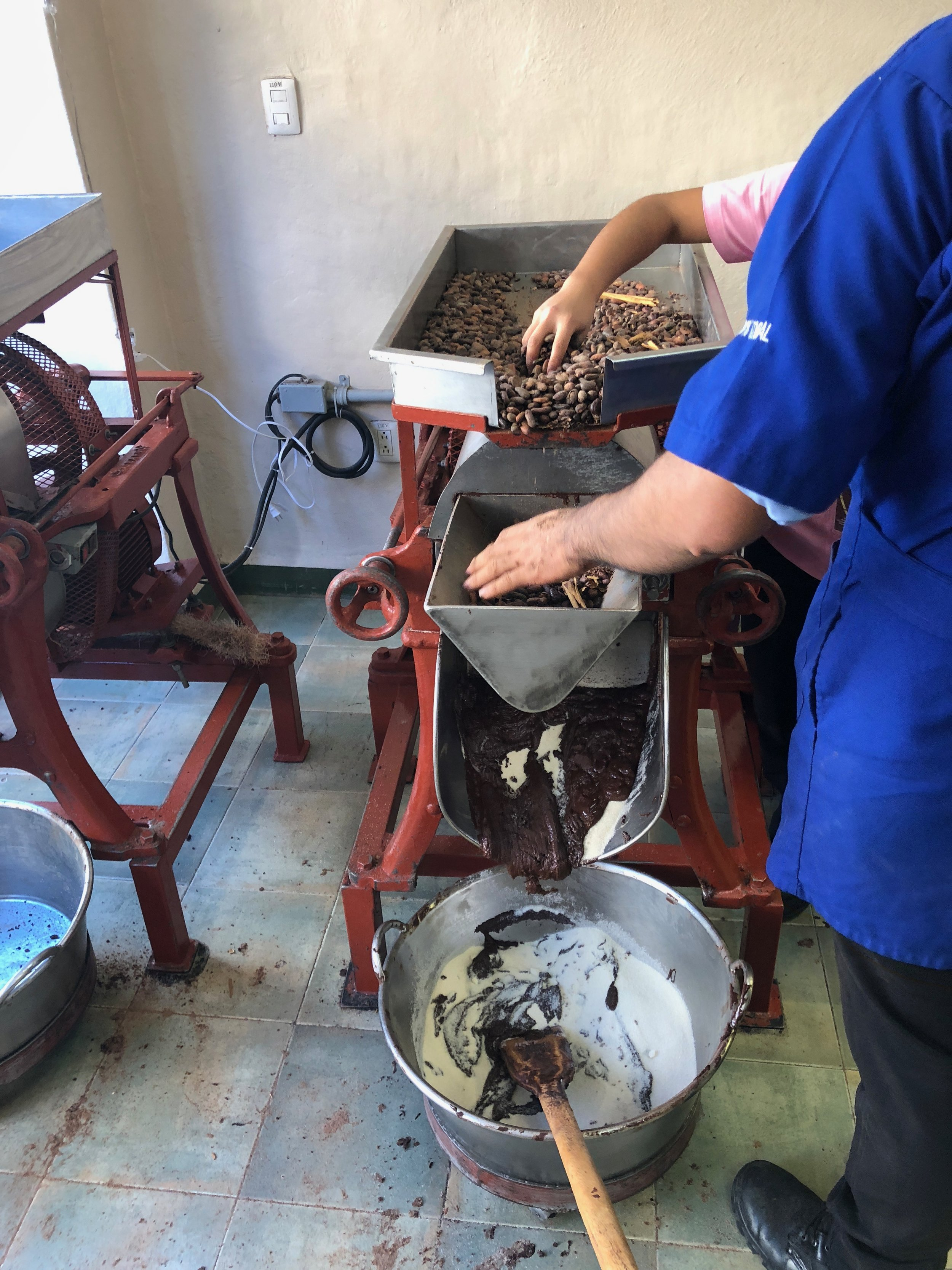 """The cacao, cinnamon, almonds and sugar being ground and mixed for our """"cacao molienda"""""""