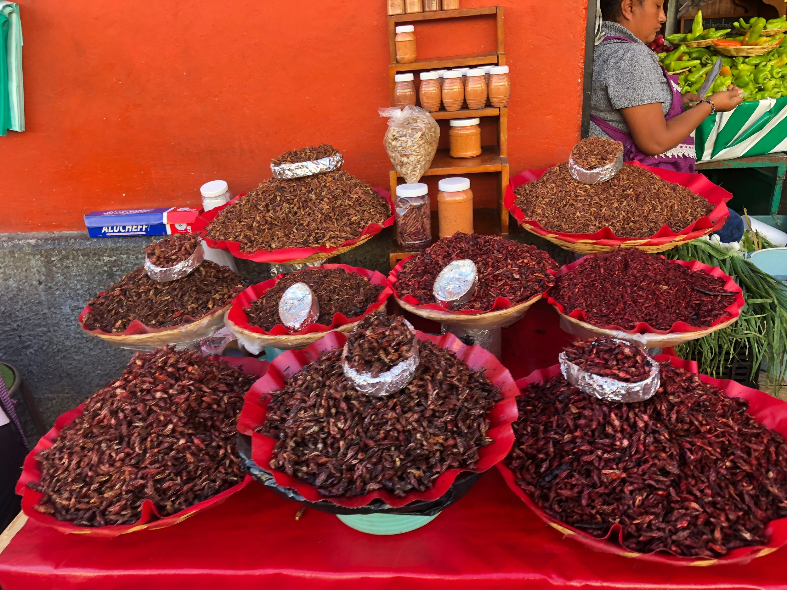 """An array of """"chapulines"""" (grasshoppers) for sale in varying sizes to munch on!"""